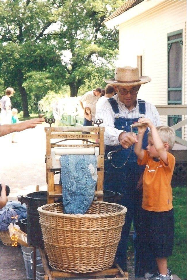 Volunteer Jim Dohren shows how the wash was done during one of Kline Creek's Farm chores programs.