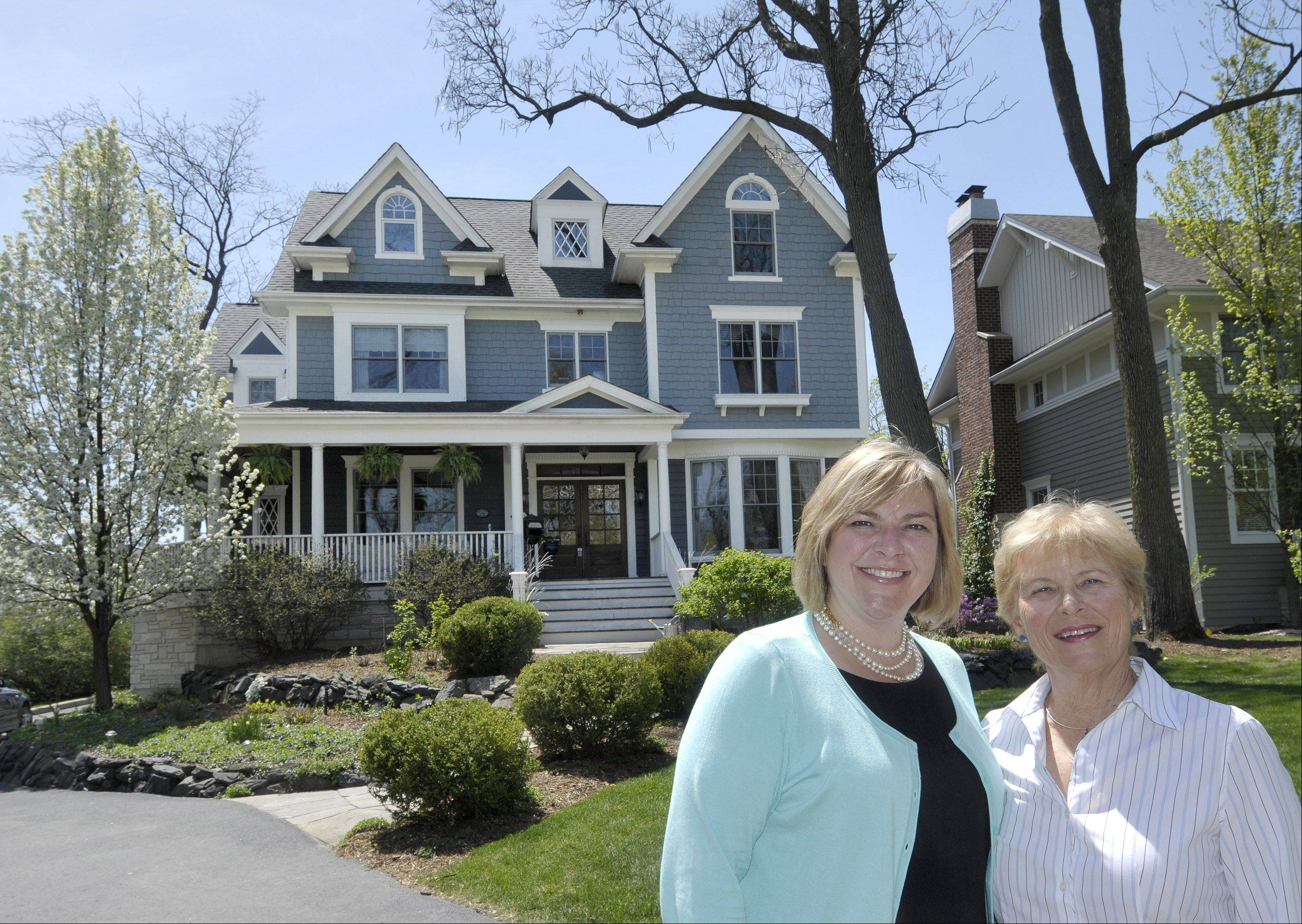 Beth Gorz, left, and her mother Karen Gorz sell real estate together for Keller Williams Premiere Properties in Glen Ellyn.