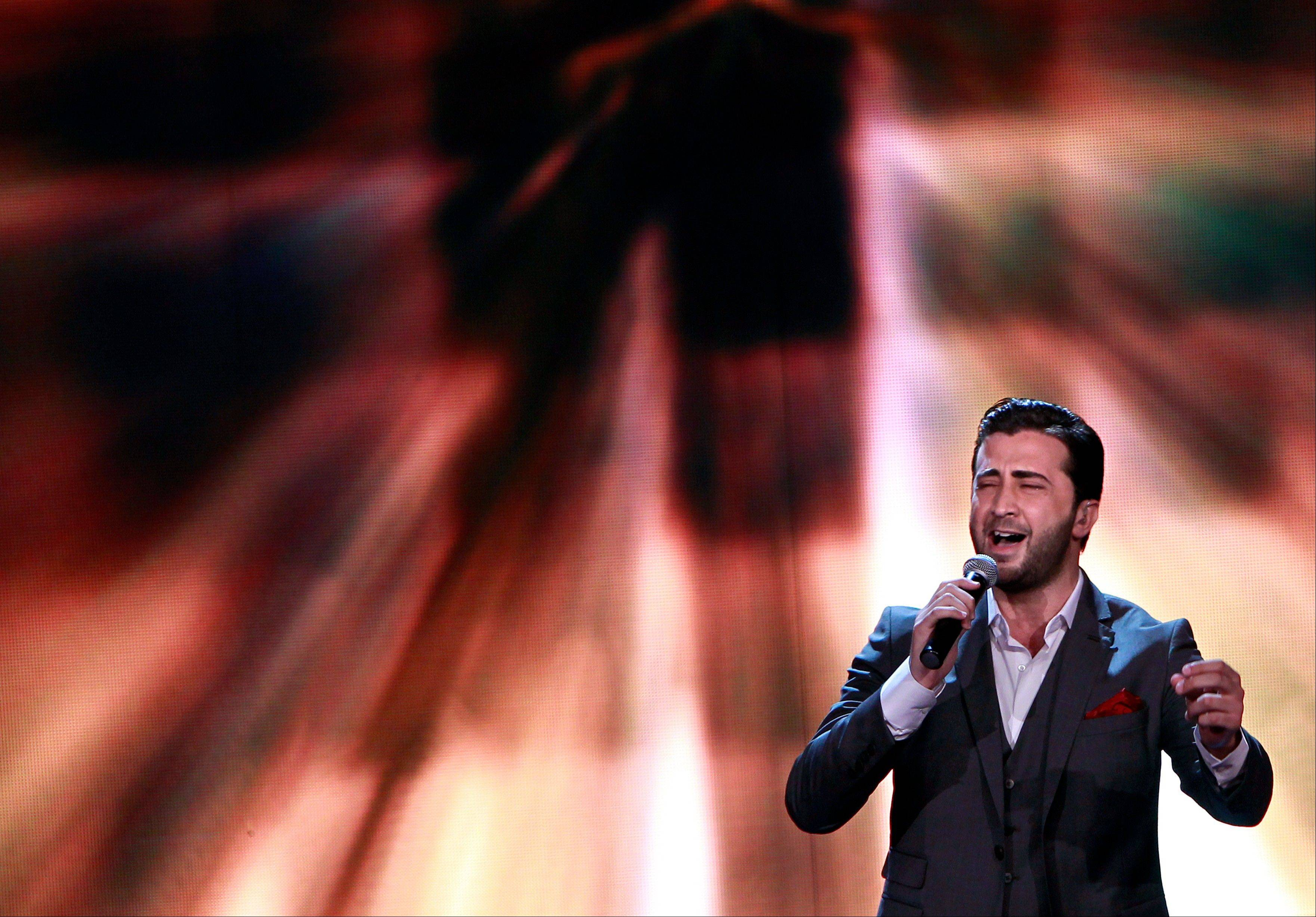 Syrian singer Abdel Karim Hamdan performs during the Arab Idol Show broadcast by MBC Arabic satellite channel.