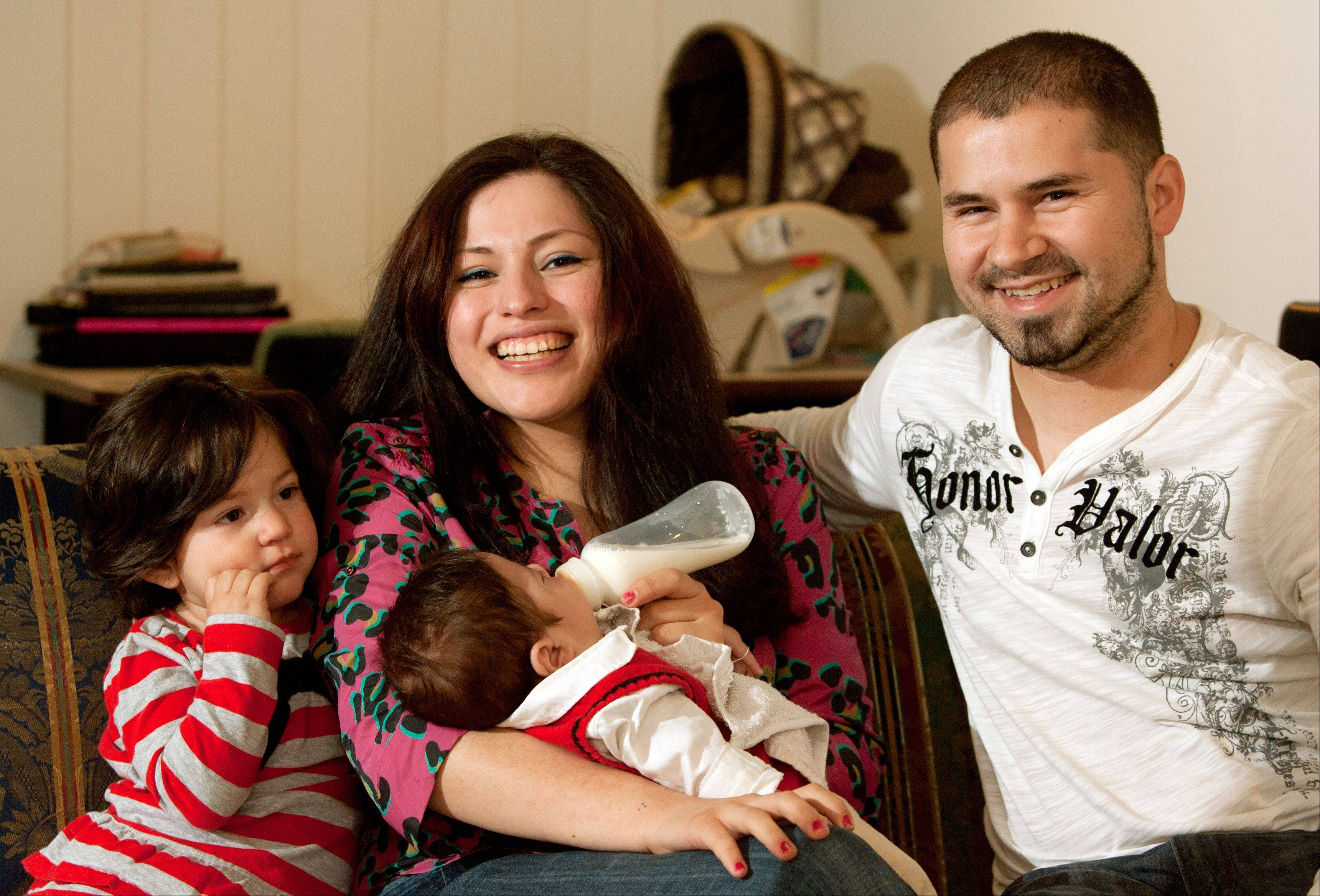 A lifesaving surgery for John Carlos Guzman, born on Valentine's Day, gives his mom, Sofia Espinoza, his dad, Juan Carlos Guzman, and their daughter, Emily Jaylin Guzman, 2, reason to celebrate as a family this Mother's Day.