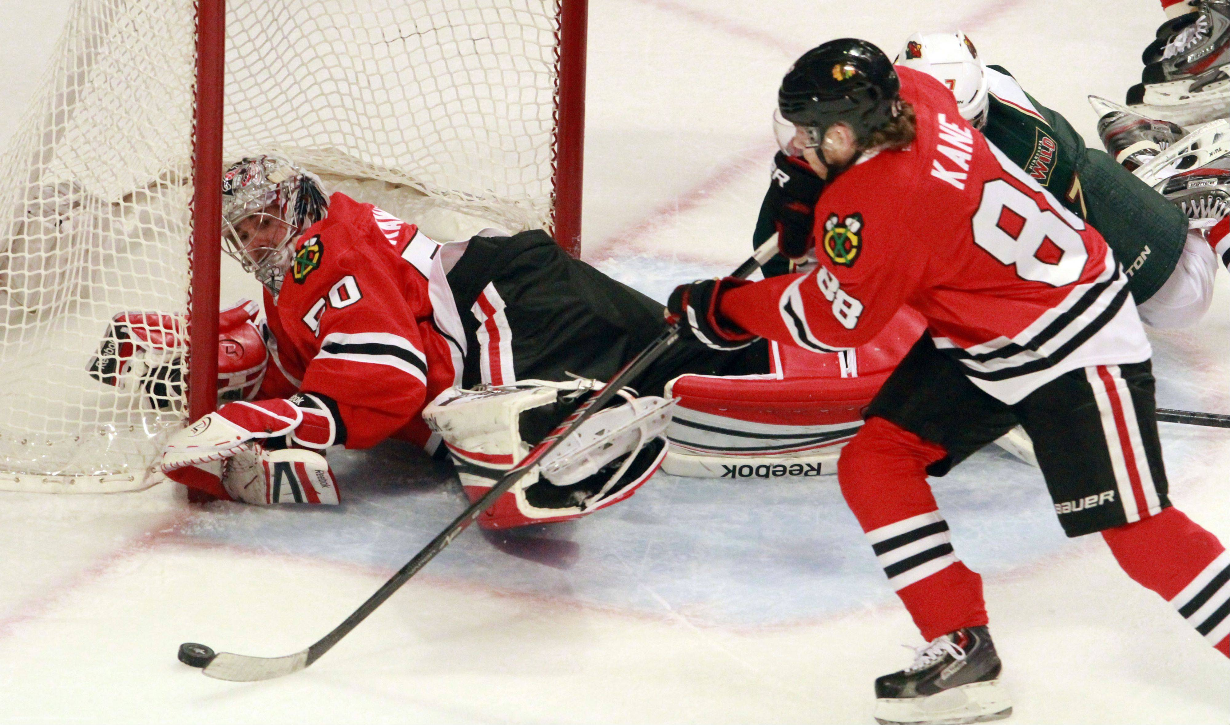 Patrick Kane, here clearing the puck out for goalie Corey Crawford in Game 5 against Minnesota, and the rest of the Blackhawks know things will intensify in Round 2 of the playoffs.