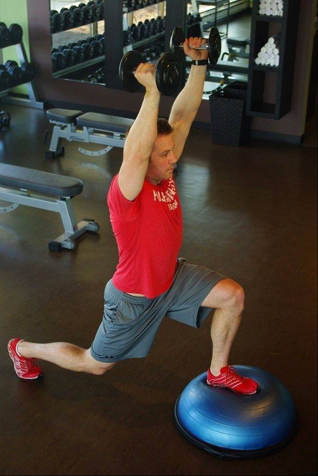 BOSU lunge to overhead press