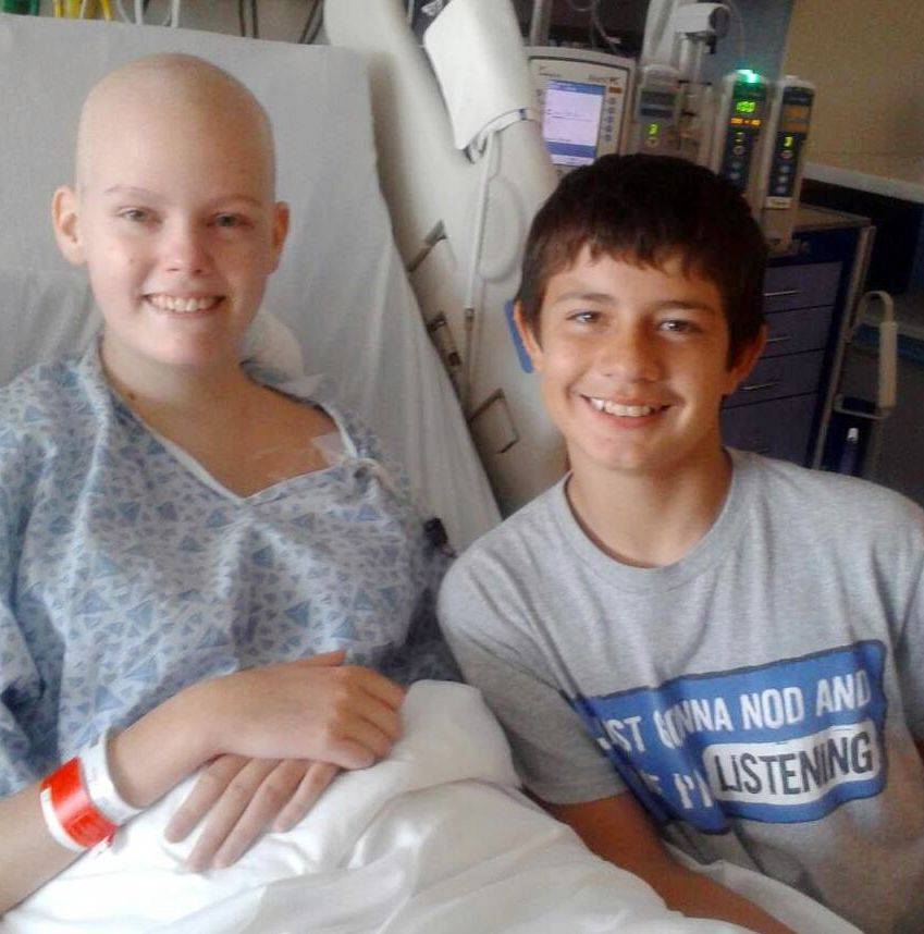 Tony Colton, right, with Ashley Krueger in November 2012 at All Children's Hospital in St. Petersburg, Fla. The two teens, who are fighting cancer, are providing emotional support for each other, but also helping each other financially.