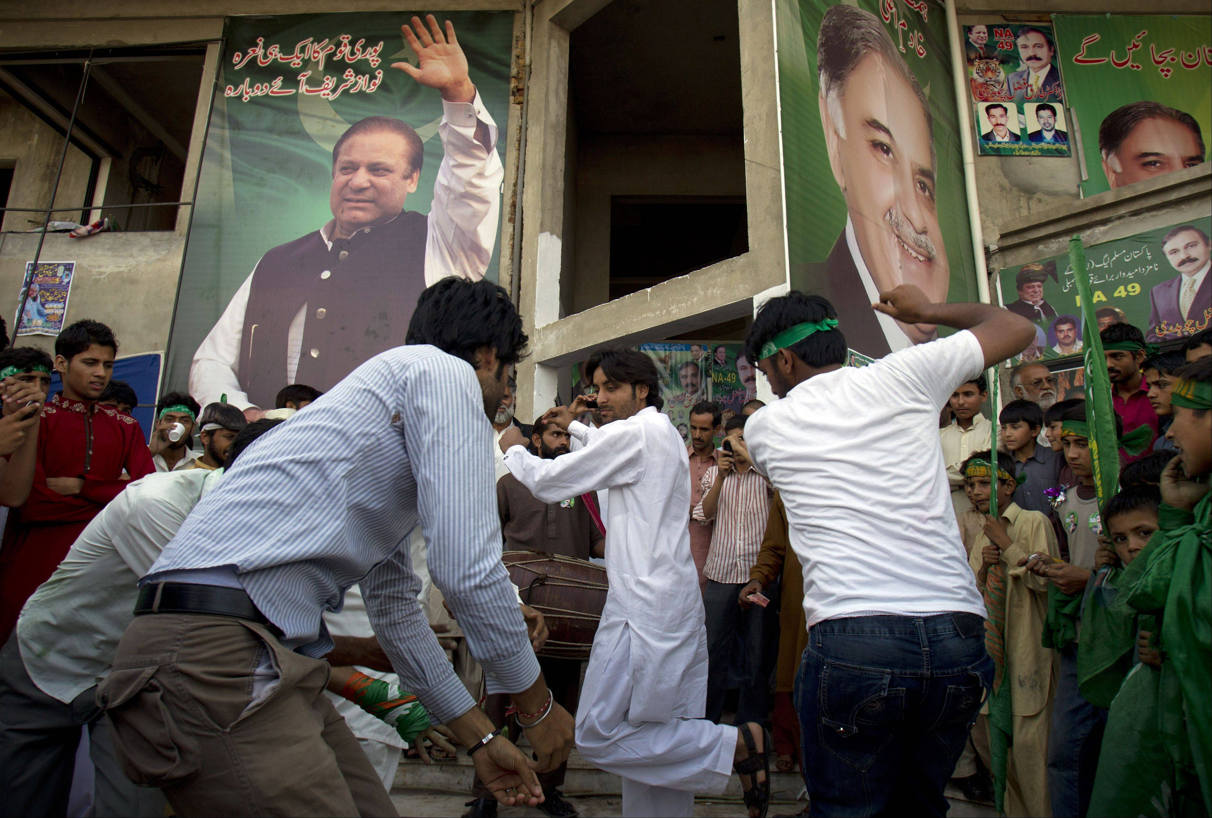 Supporters of Pakistan's former Prime Minister Nawaz Sharif celebrate the victory of their leader in Islamabad, Pakistan, on Sunday.