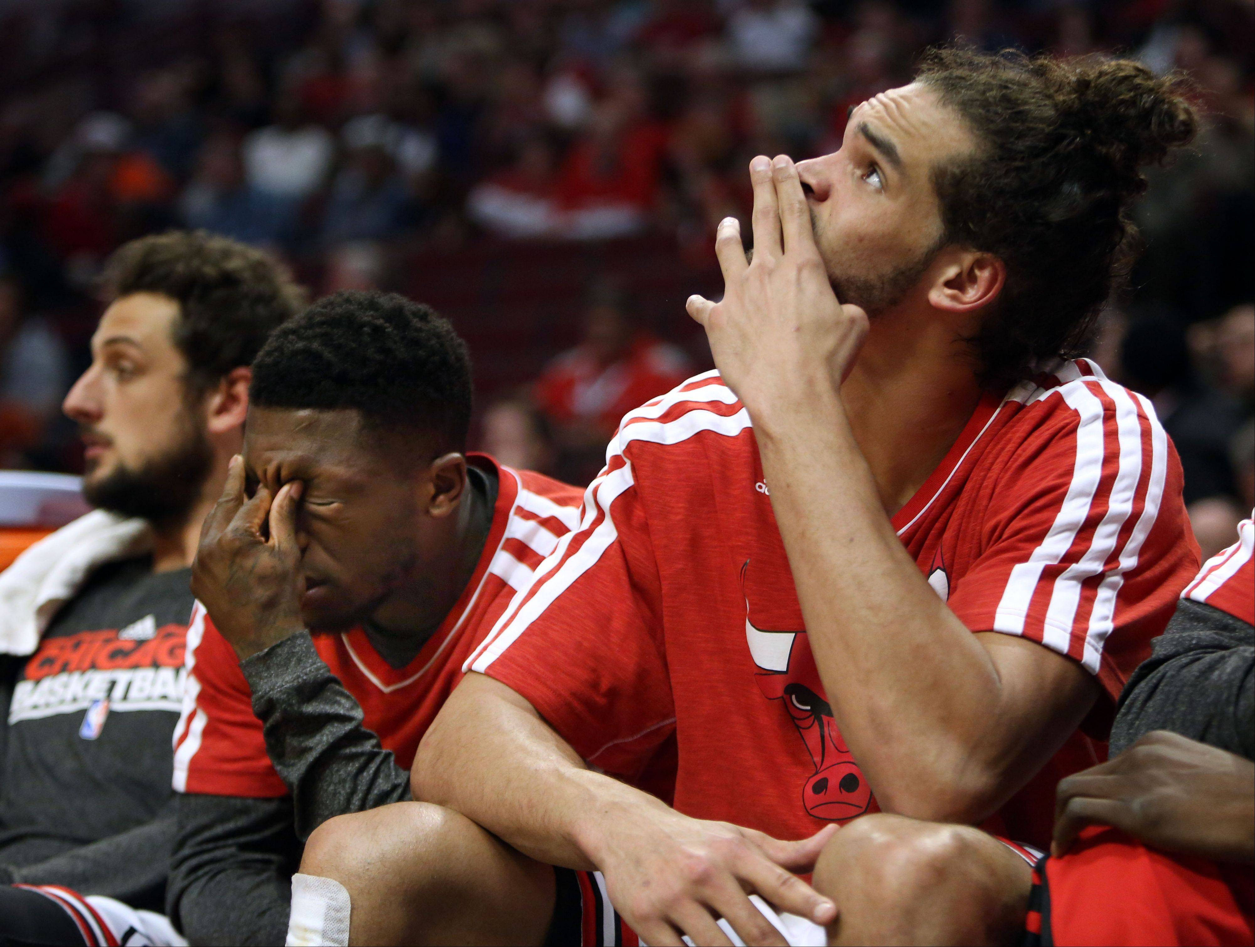 Chicago Bulls point guard Nate Robinson and Chicago Bulls center Joakim Noah sit dejected on the bench.