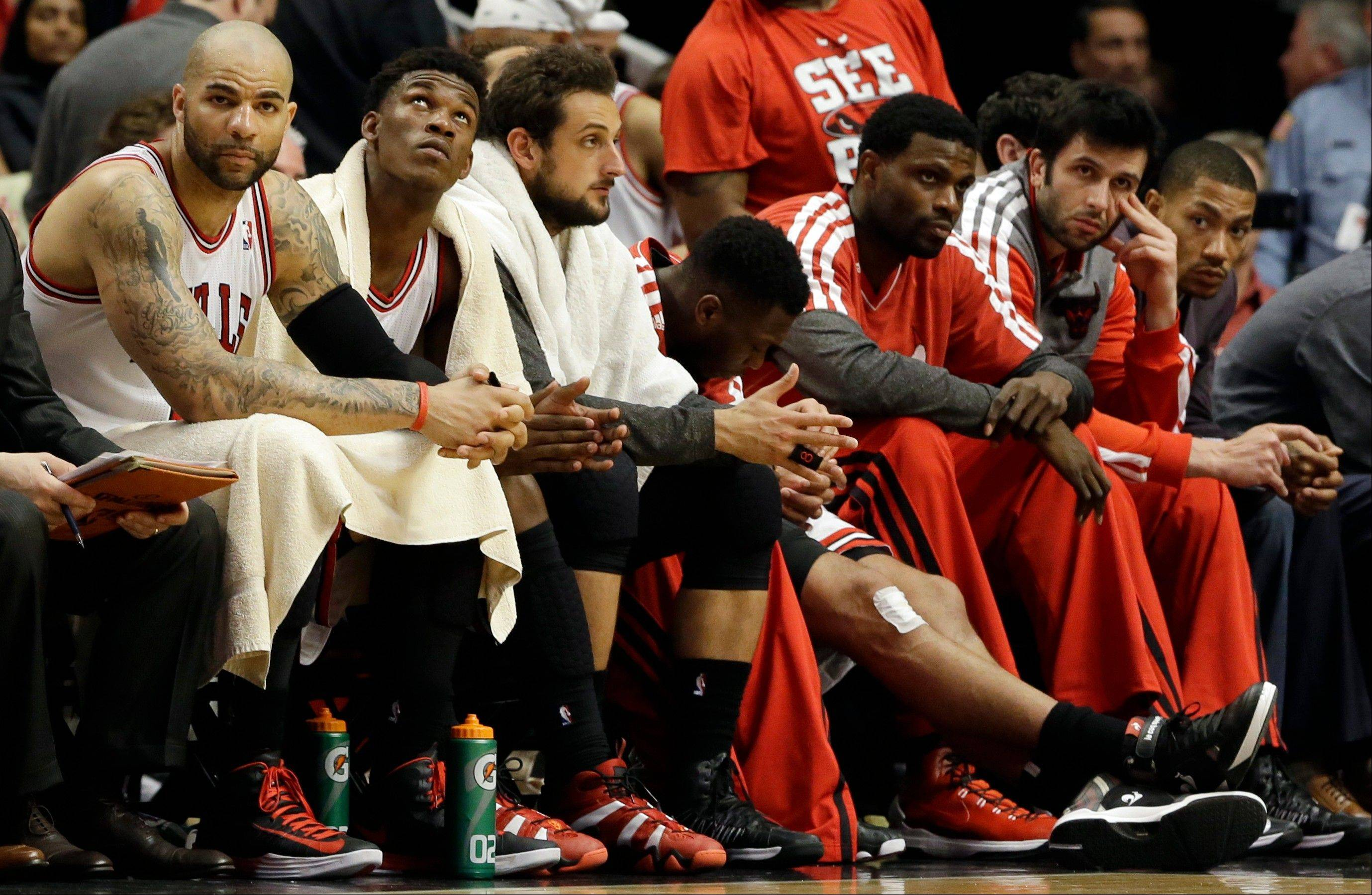 The Bulls bench watches the Miami Heat surge during the second half of Game 4 of an NBA basketball playoffs Eastern Conference semifinal against the Miami Heat on Monday, May 13, 2013, in Chicago. The Heat won 88-65.