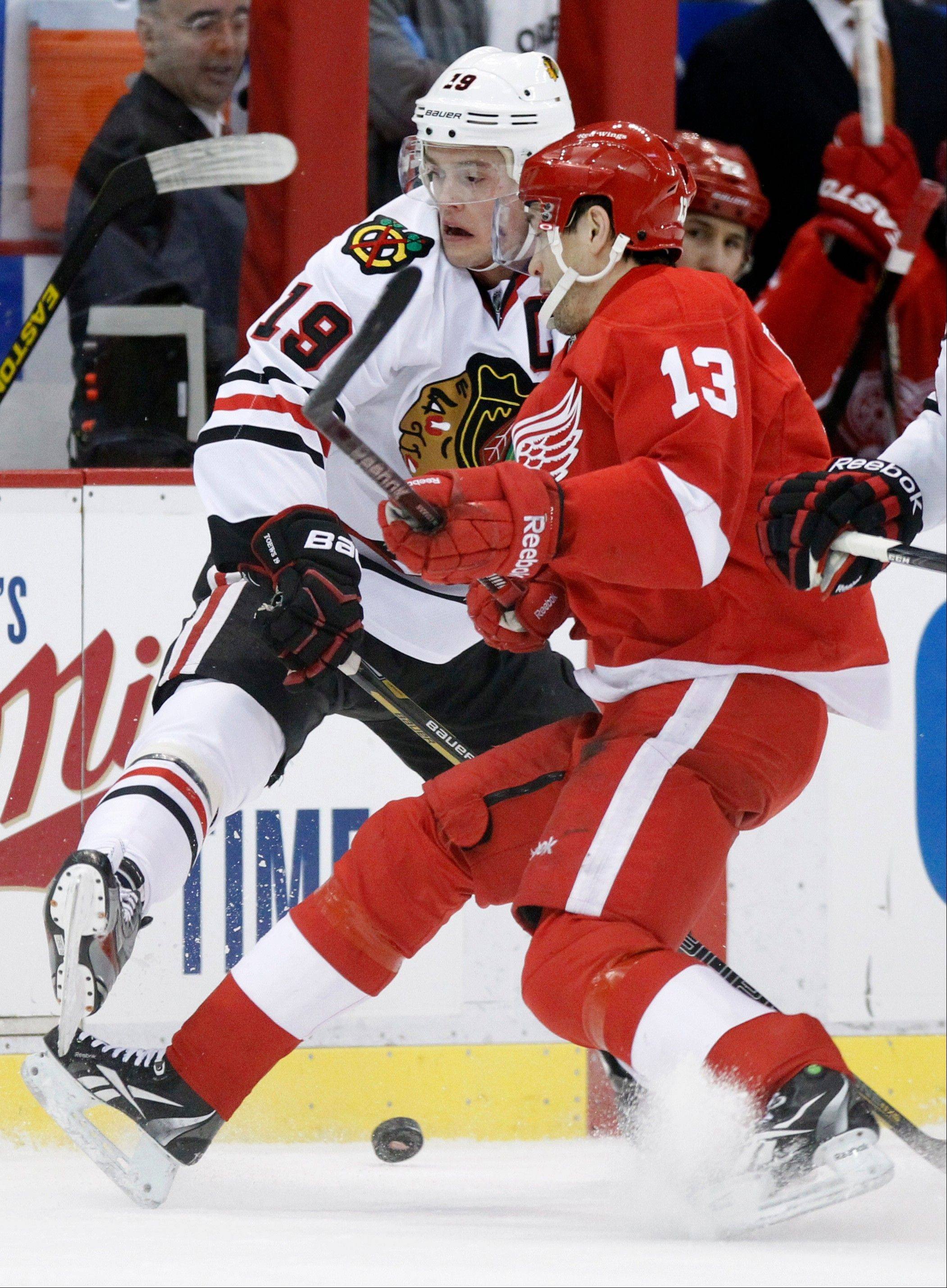 Stopping Detroit Red Wings center Pavel Datsyuk, here colliding with Blackhawks captain Jonathan Toews, will be one of the keys for the Hawks when they return to action at 7 p.m. Wednesday for Game 1 of their conference semifinals series at the United Center.
