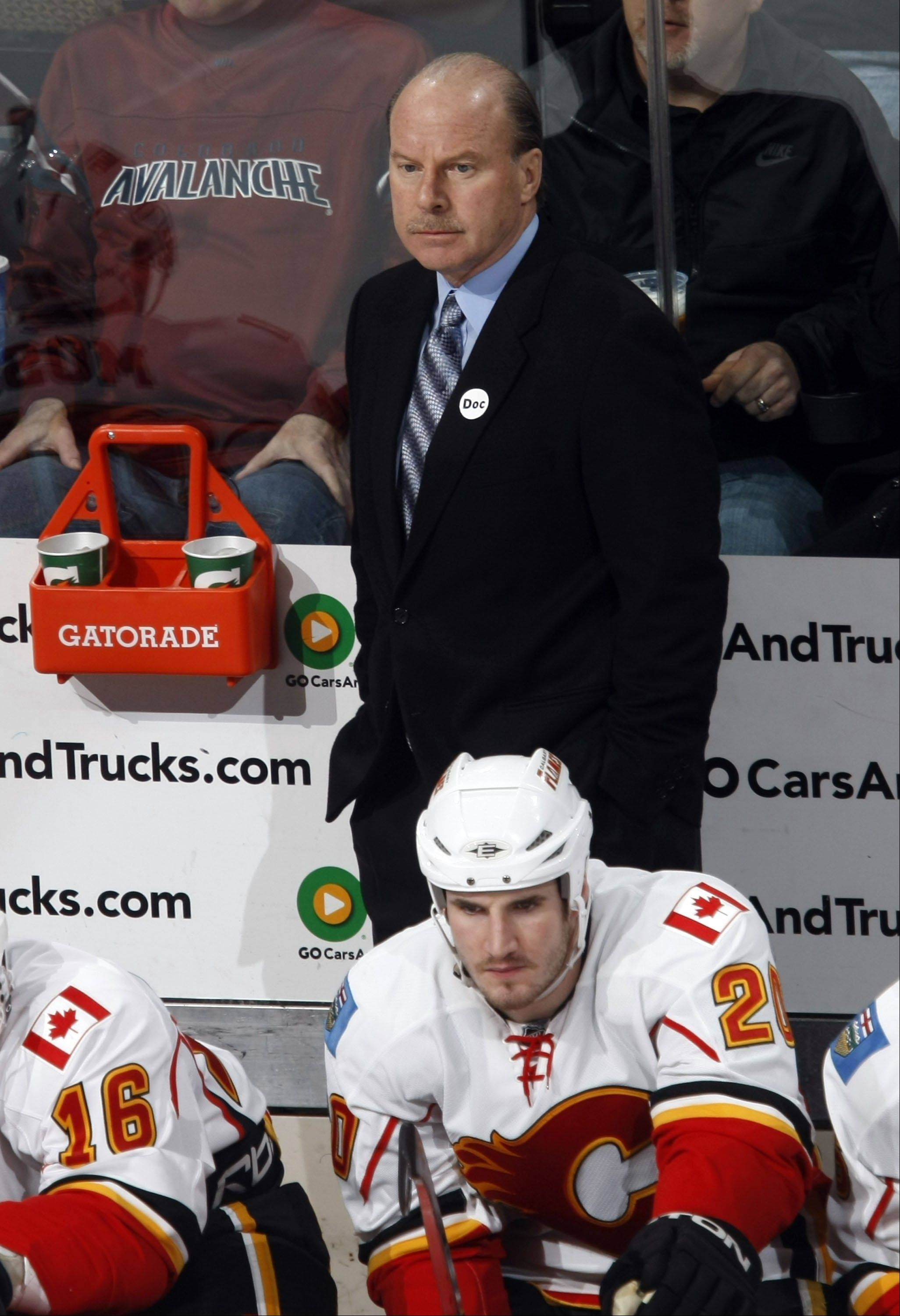 former Calgary Flames head coach Mike Keenan, who also coached six other NHL franchises, has been hired to coach a Russian hockey club.