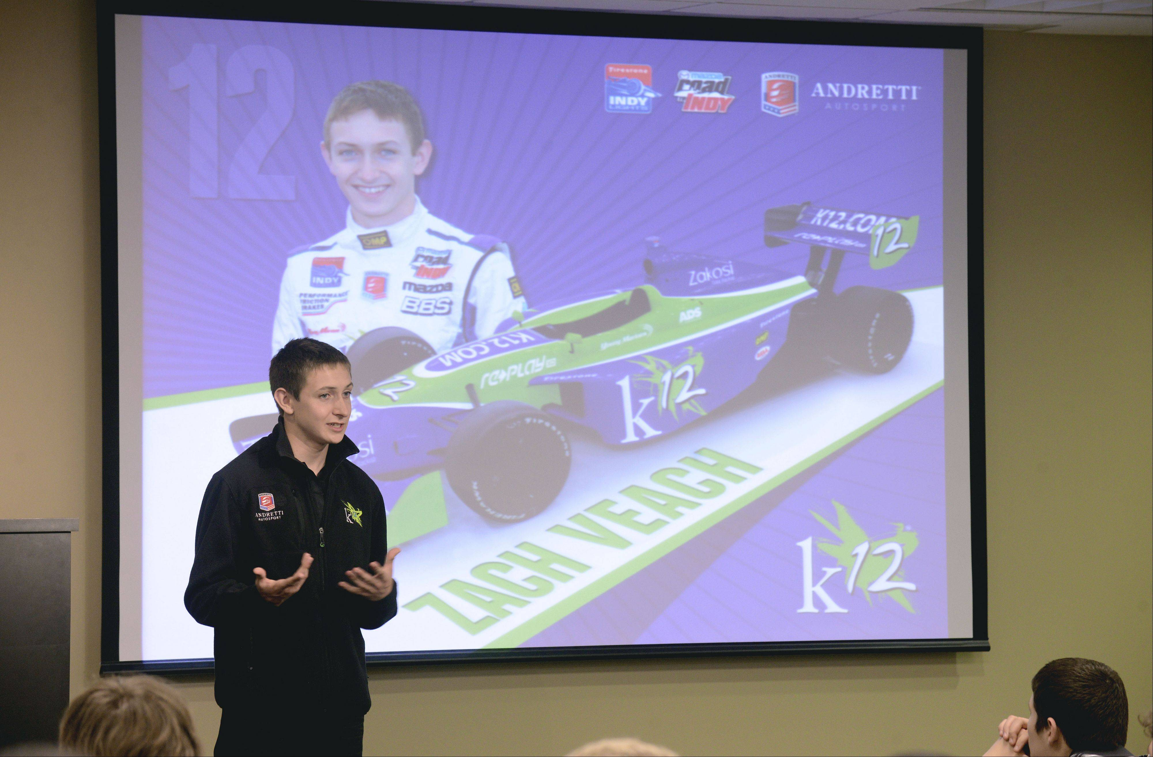 Students from Elk Grove, Buffalo Grove and John Hersey high schools joined manufacturing executives to listen to 18-year-old IndyCar driver Zach Veach talk about is career during a visit to DMG/Mori Seiki in Hoffman Estates.