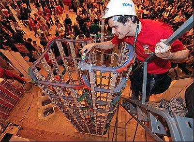 Tomy Master Builder Jason Moreno prepares to send a Chuggington die-cast railway train down a tower constructed of 17 feet, four inches of Chuggington StackTrack, which set the Guinness World Record title for tallest toy train track Saturday, at Grand Central Terminal.
