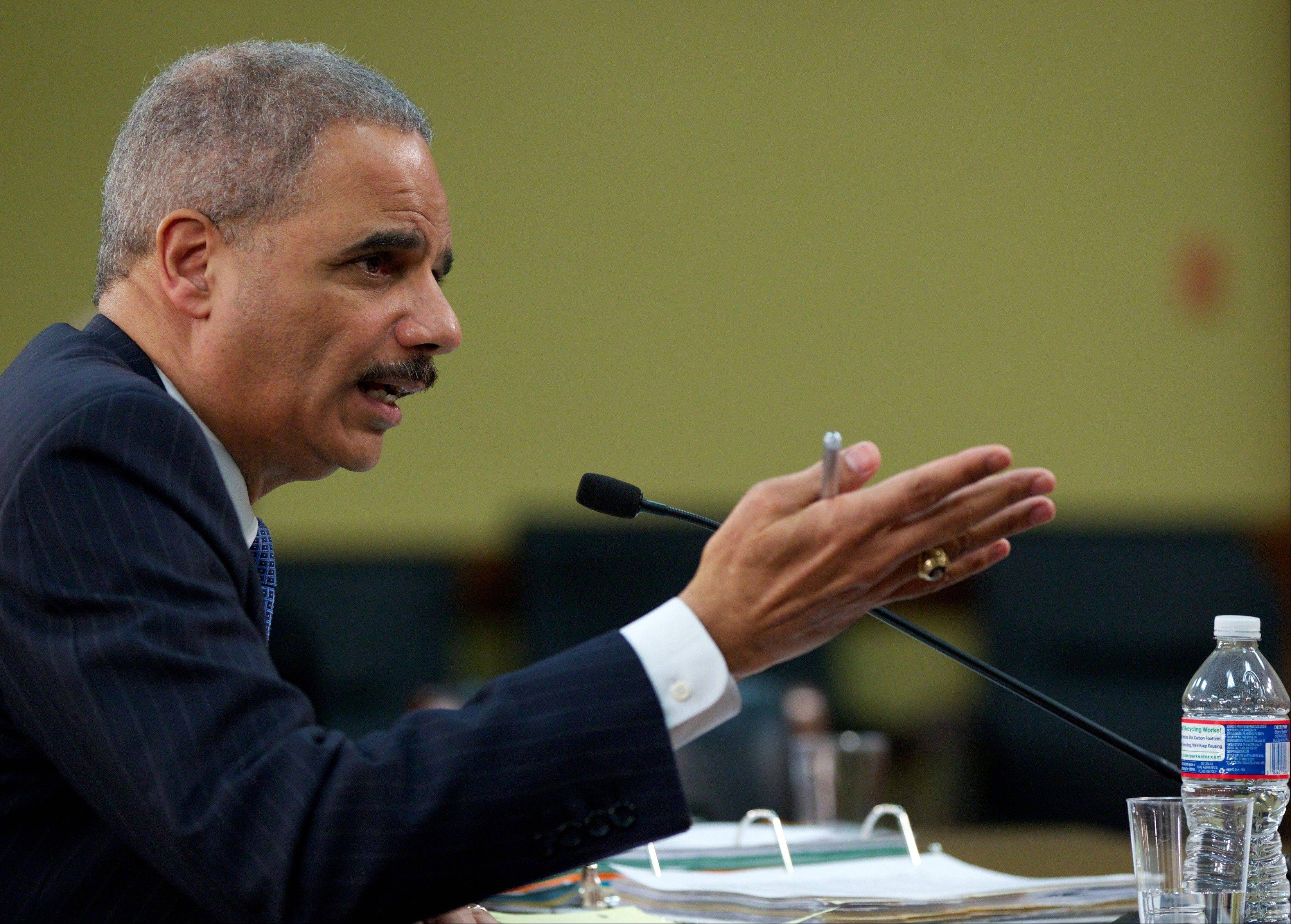 In this April 18, 2013 file photo, Attorney General Eric Holder testifies on Capitol Hill in Washington. The Justice Department has secretly obtained two months of telephone records of journalists for The Associated Press in what AP's top executive says is an unprecedented intrusion into newsgathering.