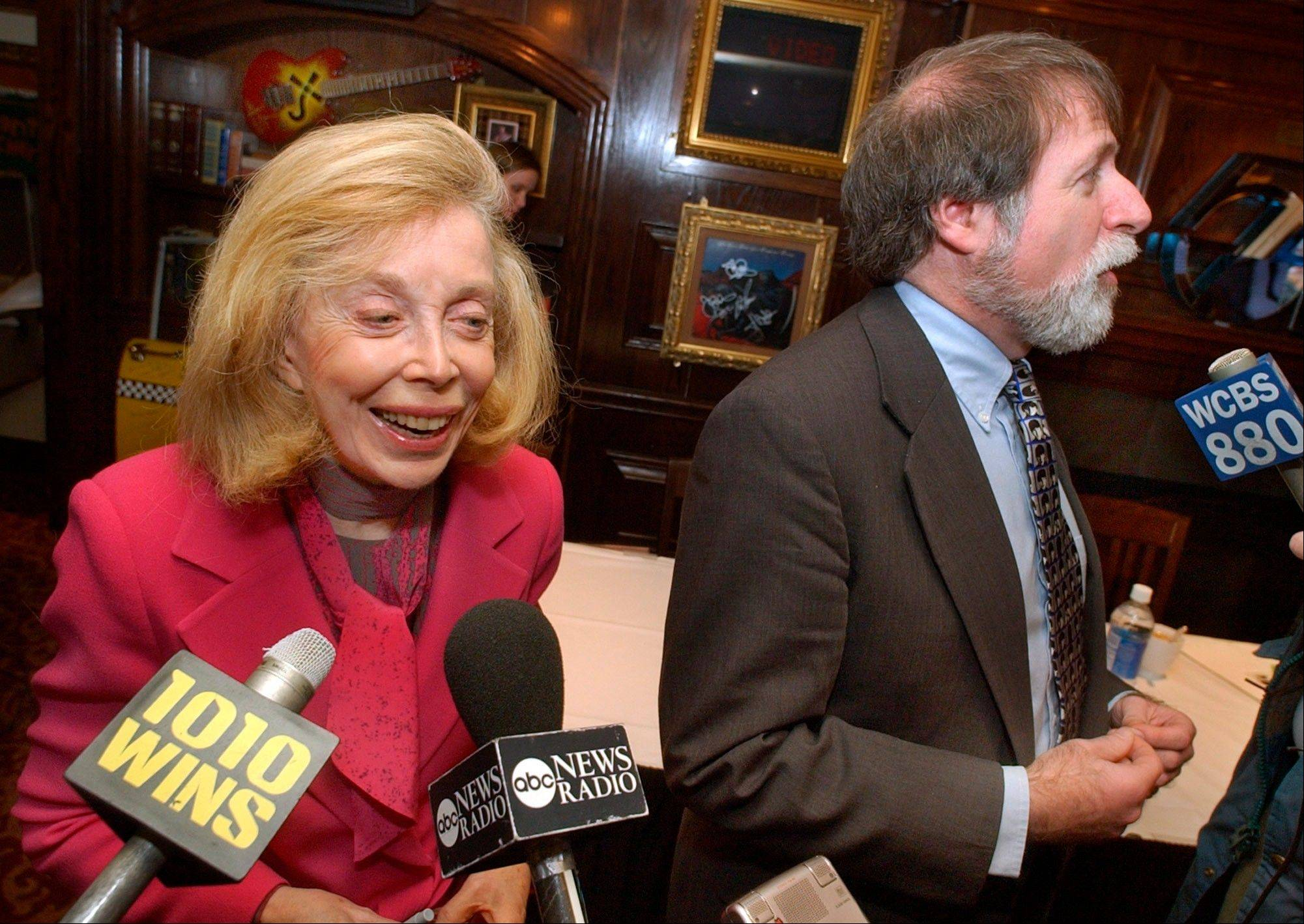 "In this Jan. 16, 2004 file photo, psychologist Dr. Joyce Brothers, left, and Bruce Spizer, author of ""The Beatles are Coming,"" are interviewed at a news conference in New York. Brothers died Monday, May 13, 2013, in New York City, according to publicist Sanford Brokaw. She was 85."