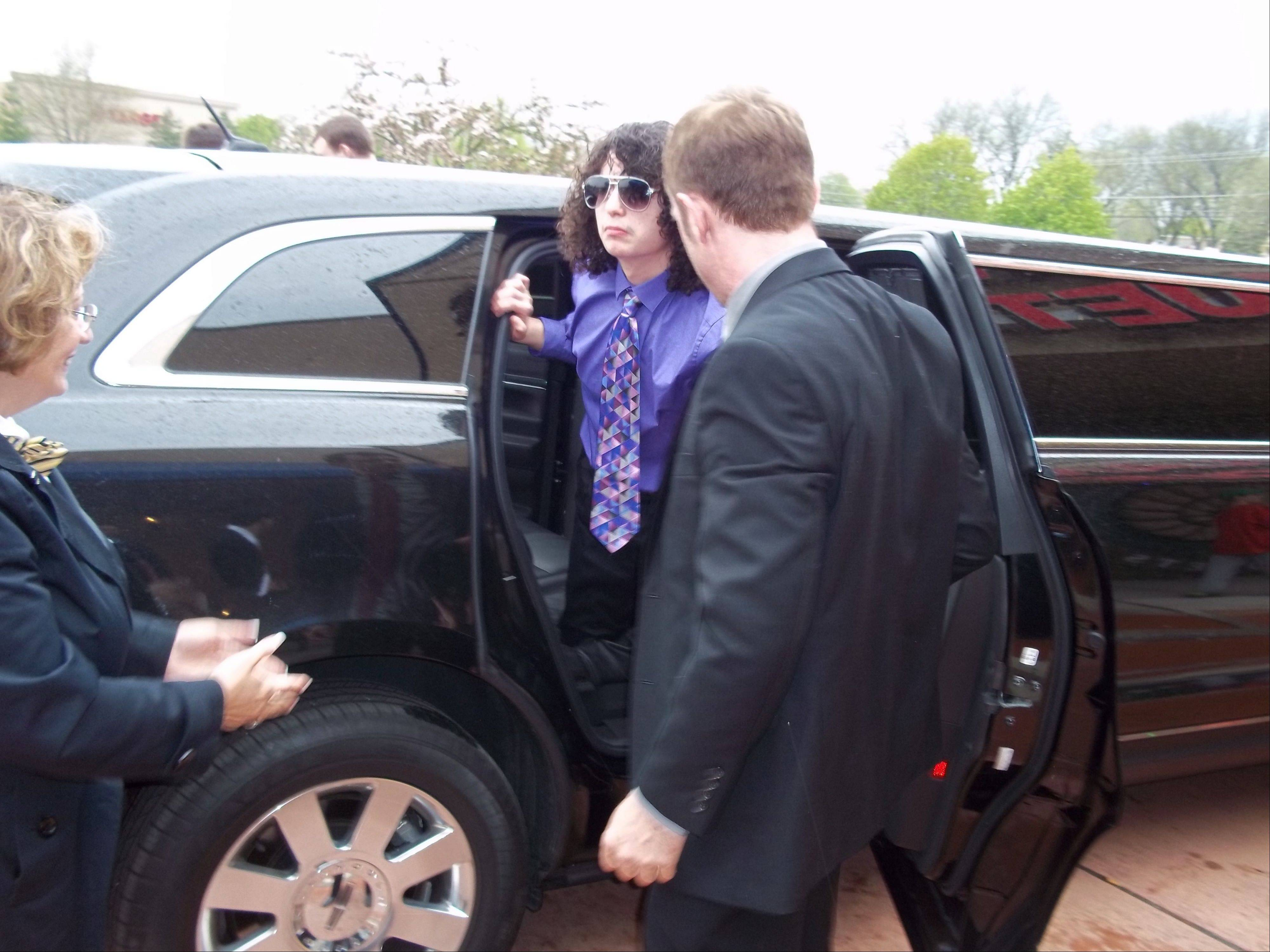 Tyler Schoebeck exits the limo that he rode to Kirk's prom.