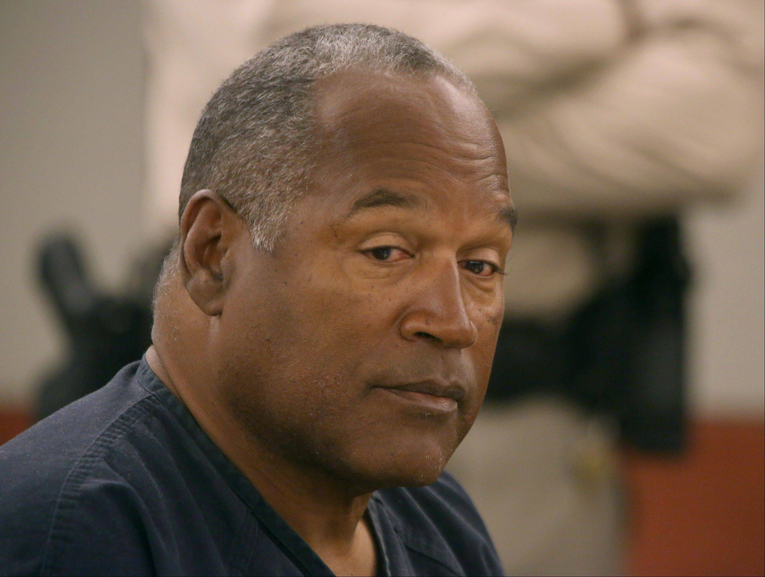 O.J. Simpson appears in court in Las Vegas Monday. Currently serving a nine-to-33-year sentence in state prison as a result of his October 2008 conviction on armed robbery and kidnapping charges, he is seeking a new trial.