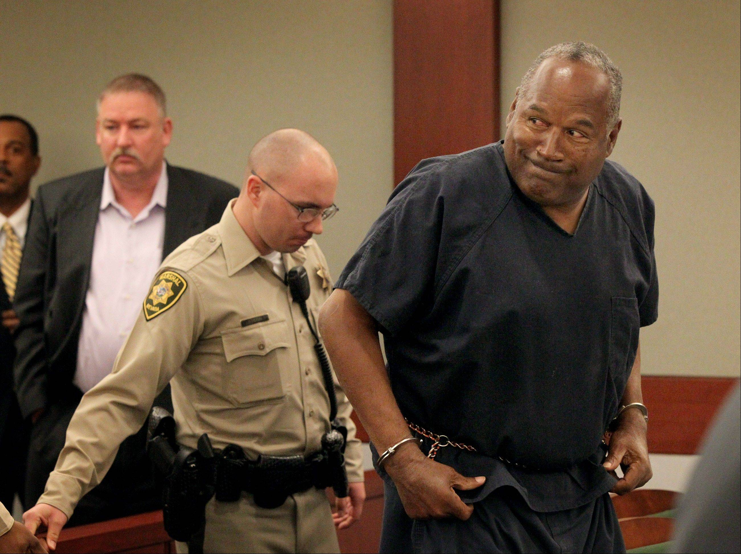 O.J. Simpson gets up after the first day at his evidentiary hearing for Simpson in Clark County District Court on Monday.
