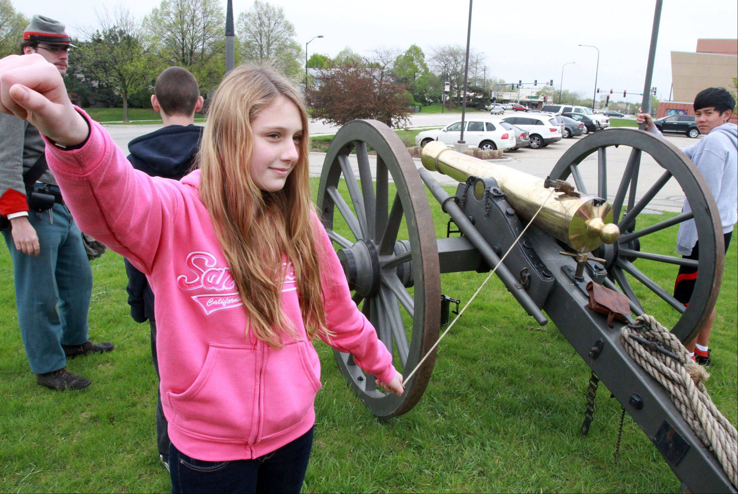 Hawthorn Middle School North seventh-grader Sheri Vaks test fires a canon as Civil War re-enactors from Stanford's Battery use just gun power during Civil War Day in Vernon Hills Friday. The day event included demonstrations and lectures from Civil War reenactors.