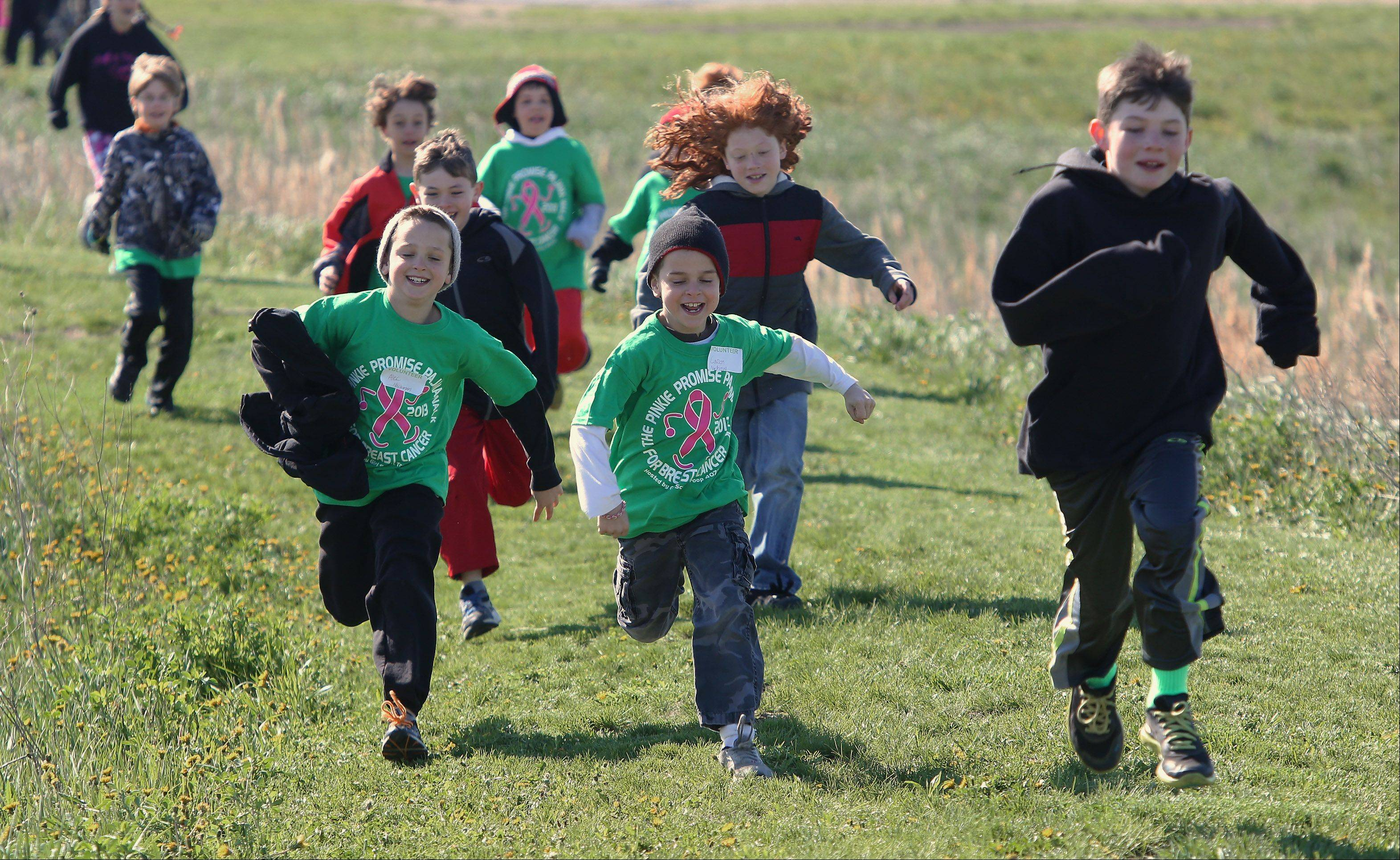 Children start running during the Second Annual Pinkie Promise Pajama Walk Sunday at Fremont Intermediate School in Mundelein. The walk was held to support breast cancer awareness in honor of Juliette Lowe, the founder of the Girl Scouts, who died of breast cancer.