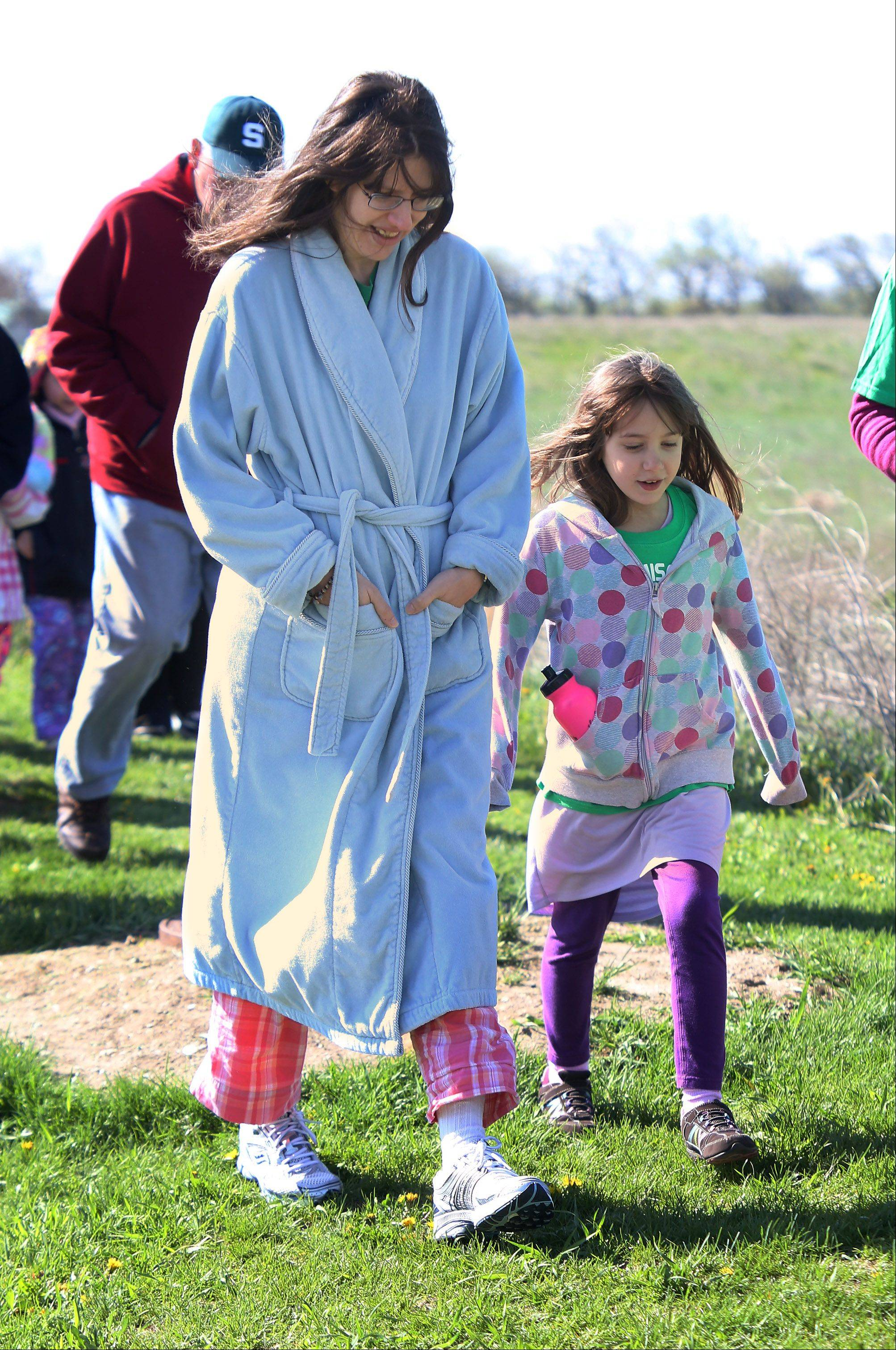 Irene Edgar, of Libertyville, walks with her daughter Gwen, 7, during the Second Annual Pinkie Promise Pajama Walk Sunday at Fremont Intermediate School in Mundelein.