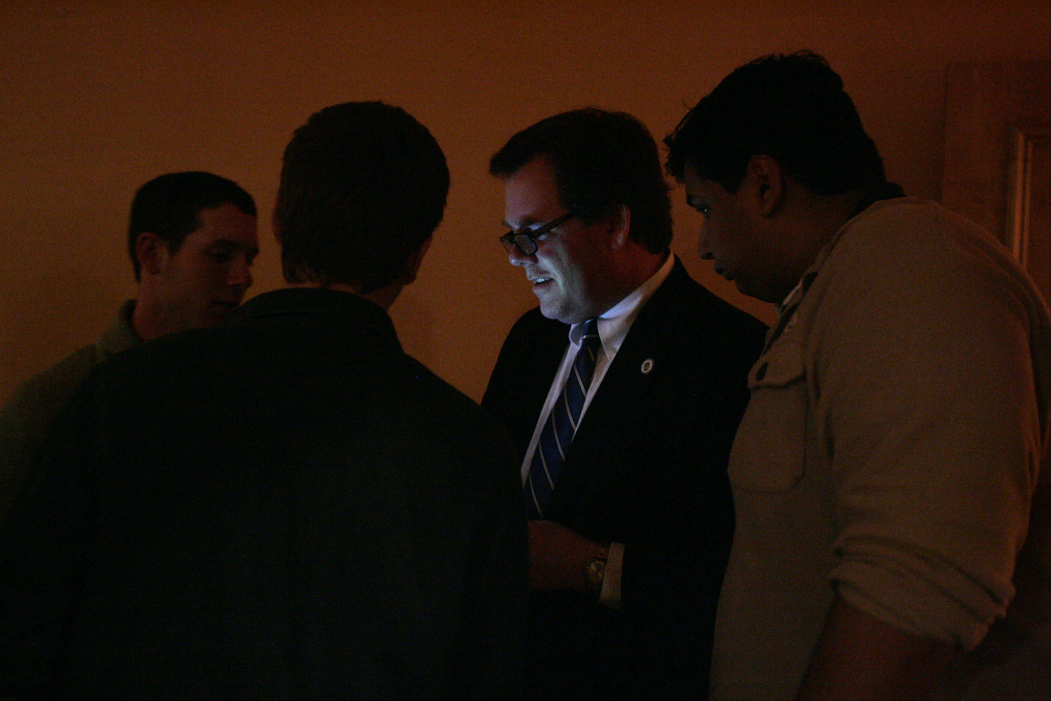 Geneva mayor Kevin Burns is lit by his cell phone as he checks results in his re-election bid at his office in Geneva on election night. I like the way the rest of the men in the photo are in the shadows. It's a little artistic, but I think it works. That is why I chose to use this photo in the Perspective column feature.