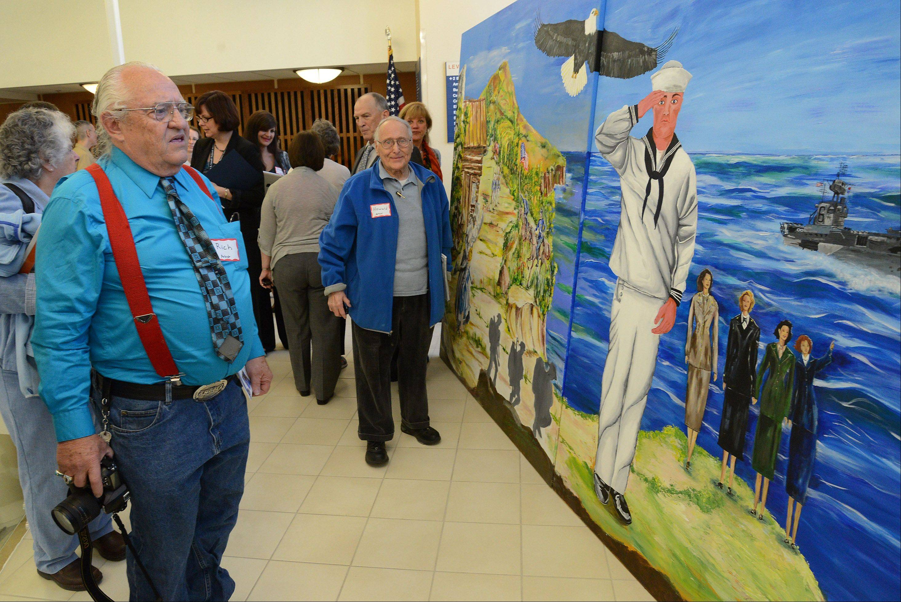 "Viet Nam veteran Richard Simmons, of Tredor, Wisconsin, left, and World War II veteran Howard Jacobs of Highland Park, were two of the many artists who worked on The Lovell Federal Health Care Center Veterans' Mural: ""Defending Freedom Through the Ages."""