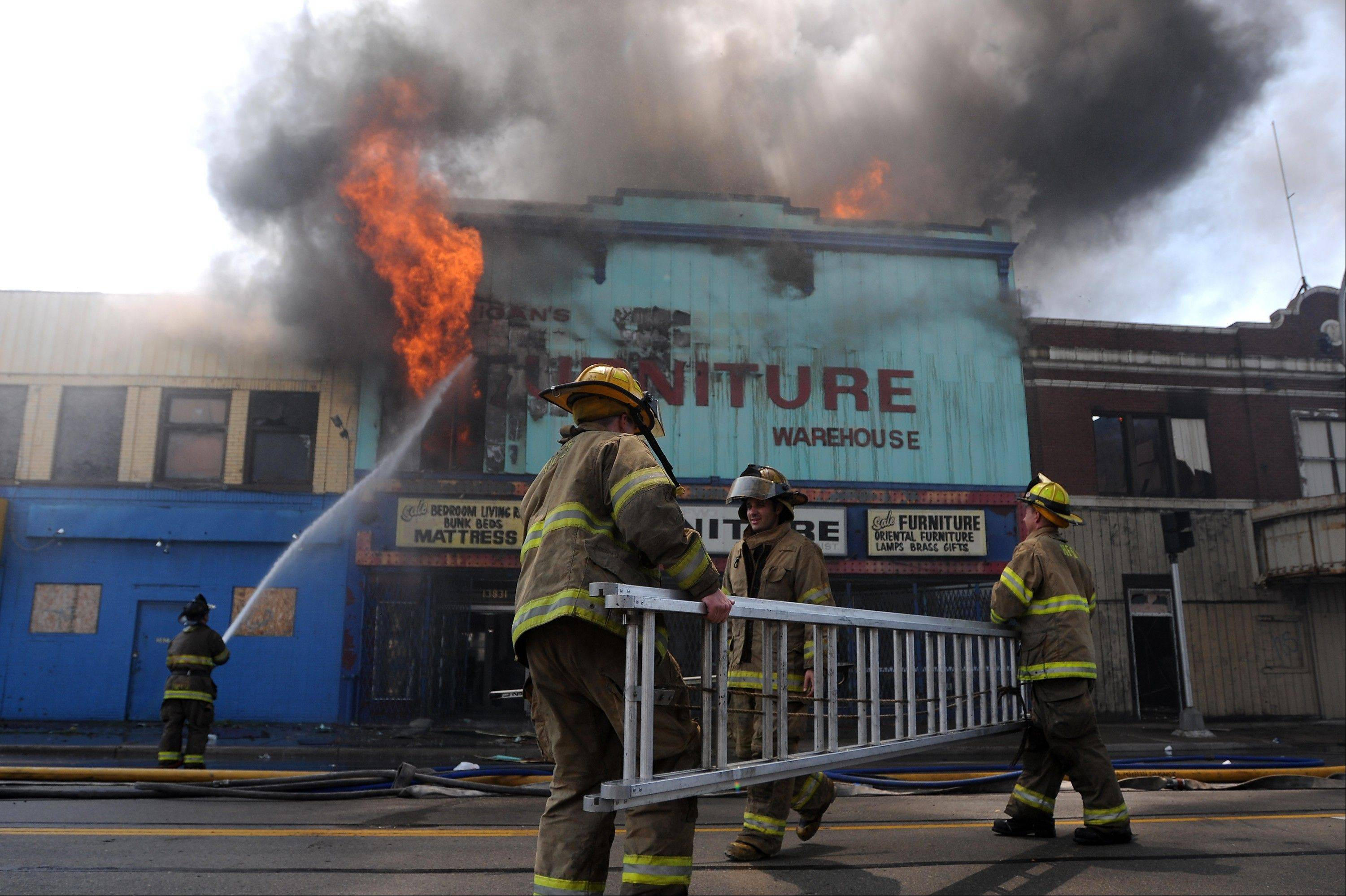 A report filed Monday by Detroit's emergency manager said the city is broke and without a massive infusion of cash or severe penny-pinching will be unable to pay for its services, including firefighting. Above, Detroit firefighters battle a building fire.