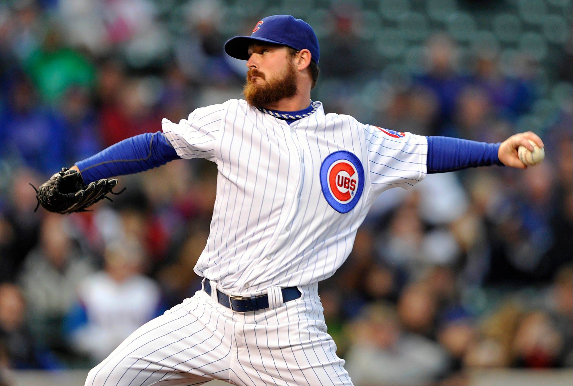 Cubs starter Travis Wood allowed only 2 hits over 7 shutout innings Monday night against the Rockies, improving his record to 4-2.