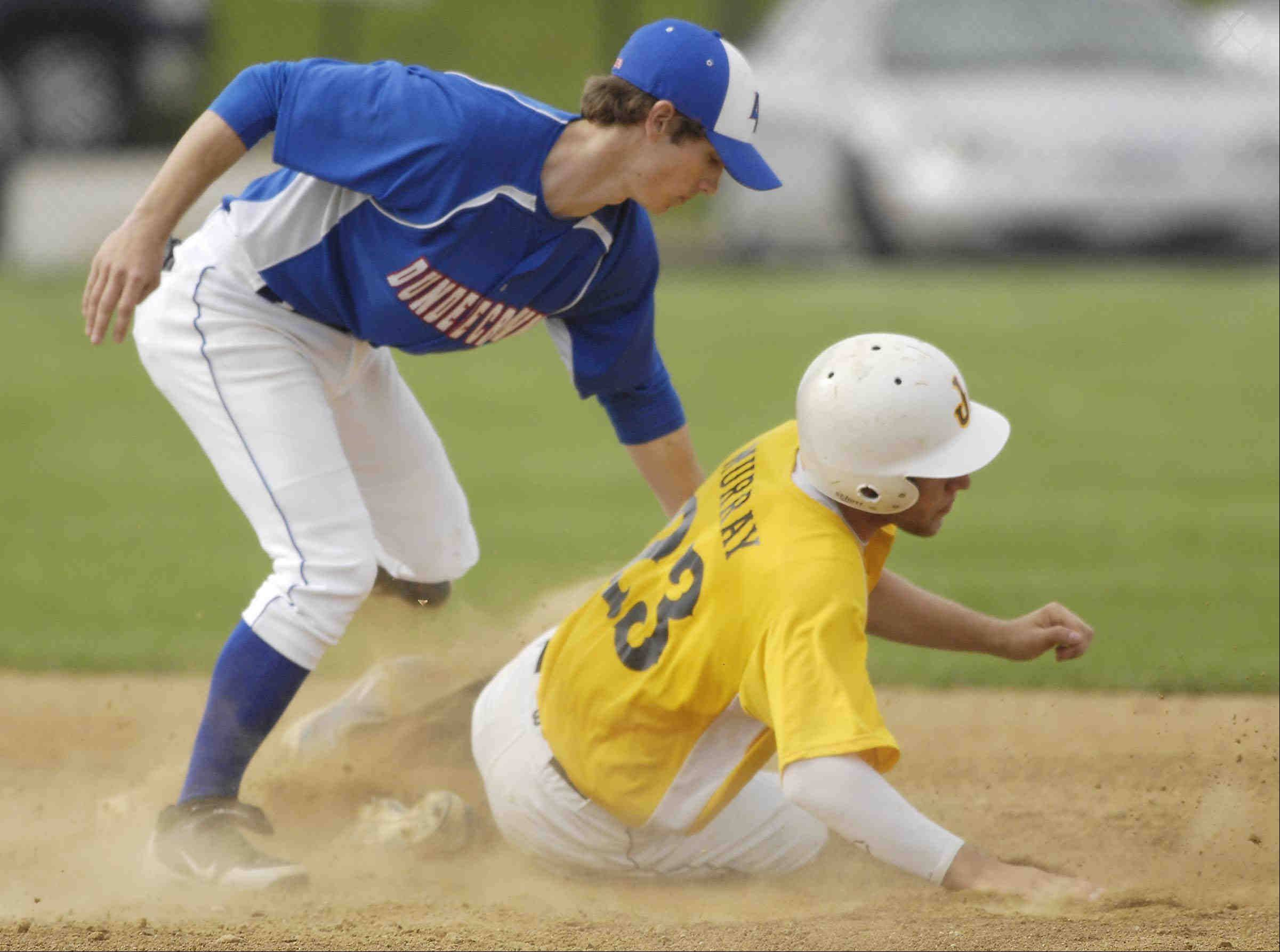 Jacobs' Ben Murray is caught at second by Dundee-Crown's Garrett Ryan after he was caught off base Monday in Carpentersville.