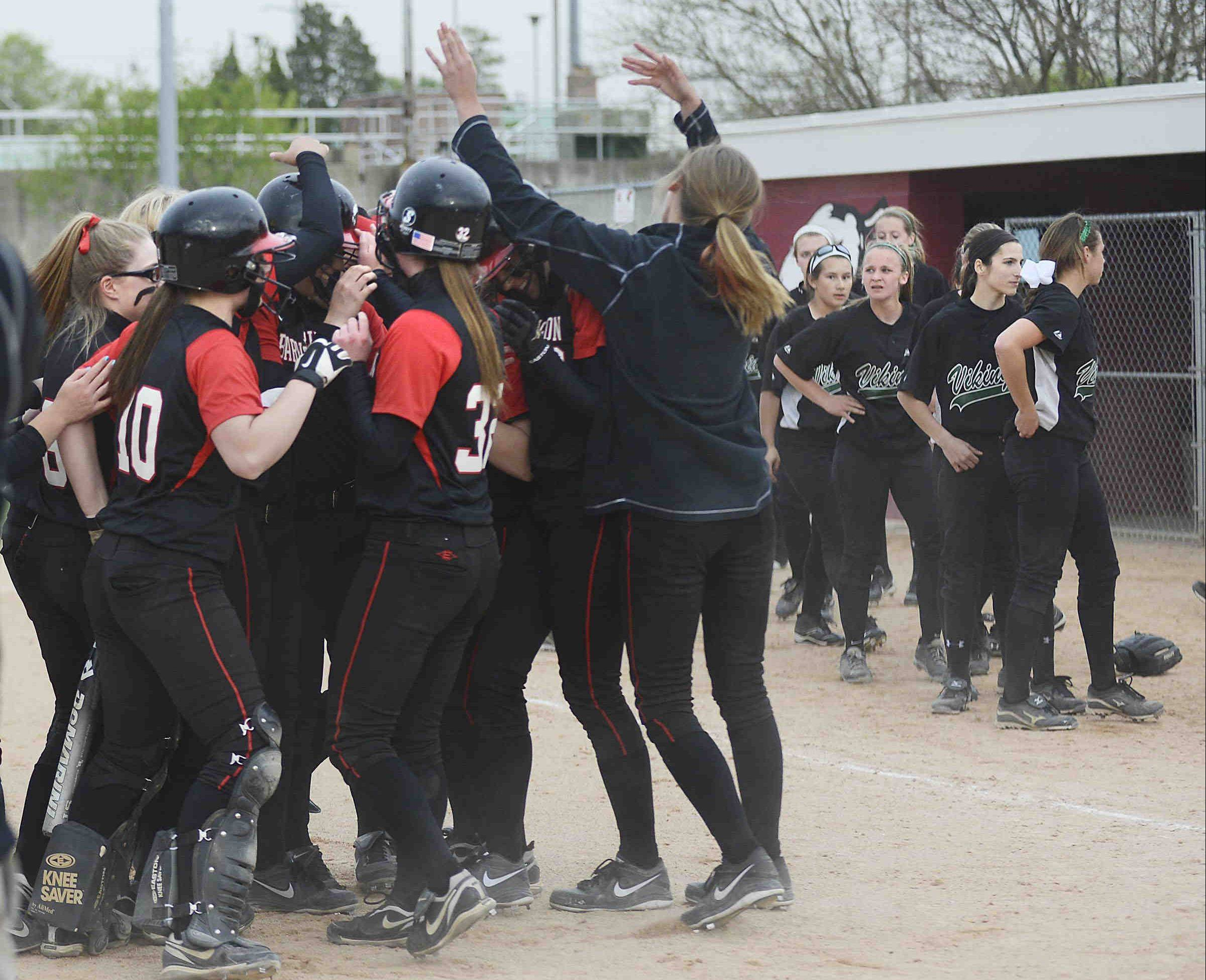 Barrington celebrates their MSL West championship as Fremd lines up to shake hands Monday at the Field of Dreams in Barrington.