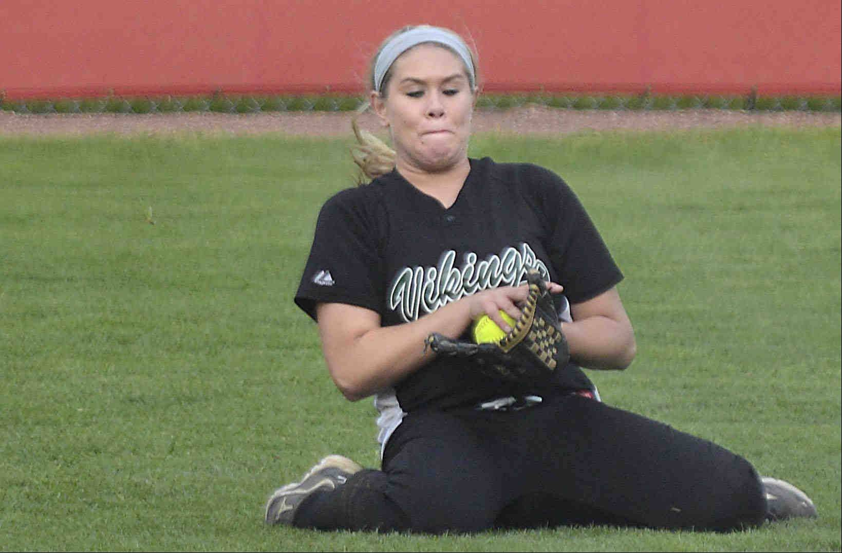 Fremd right fielder Kayla Kaufman slides to make a basket catch for the second out of the sixth inning Monday against host Barrington.