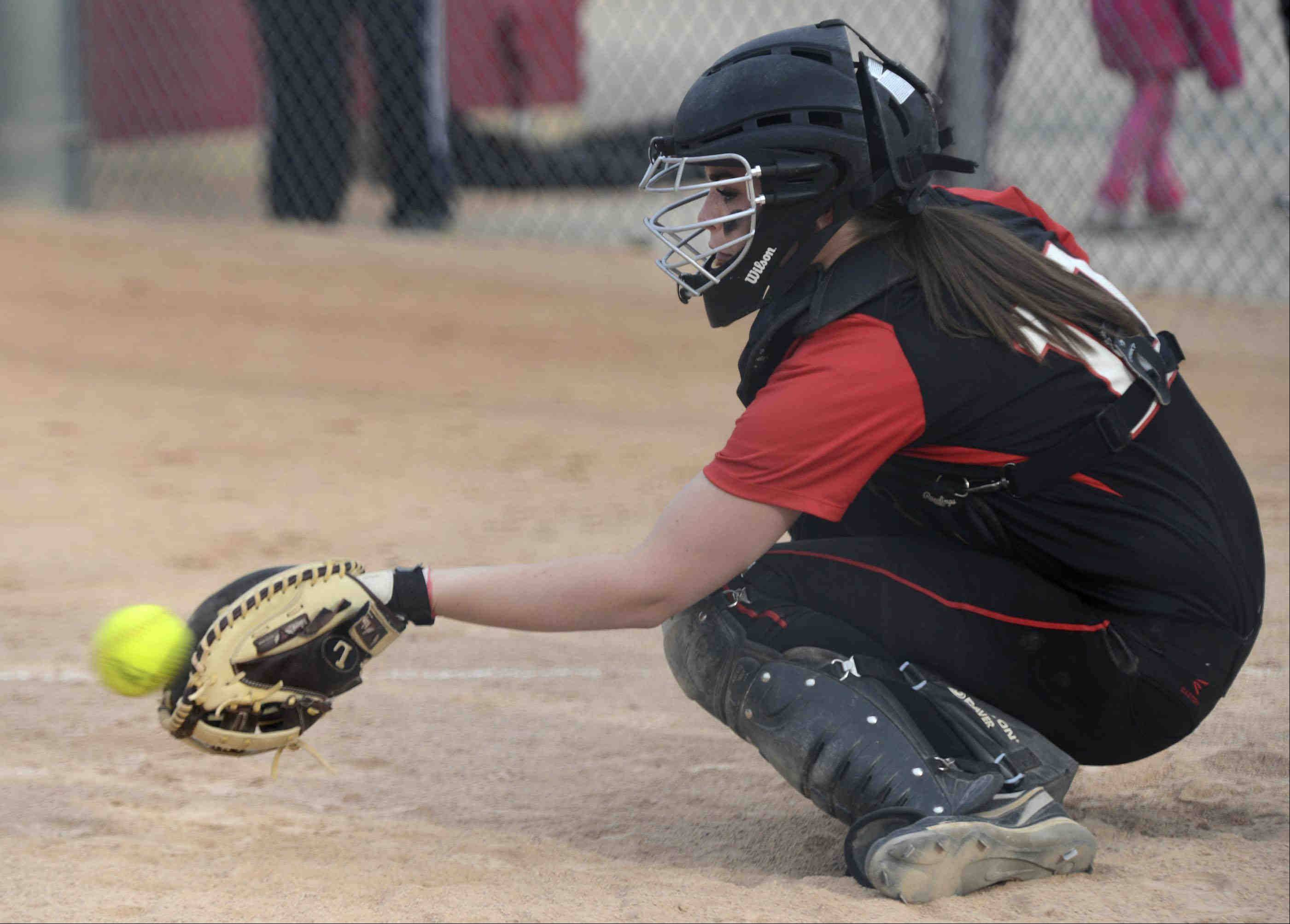 Barrington catcher Raegan Fingerman takes a pitch from Keenan Dolezal against Fremd on Monday at the Fields of Dreams.