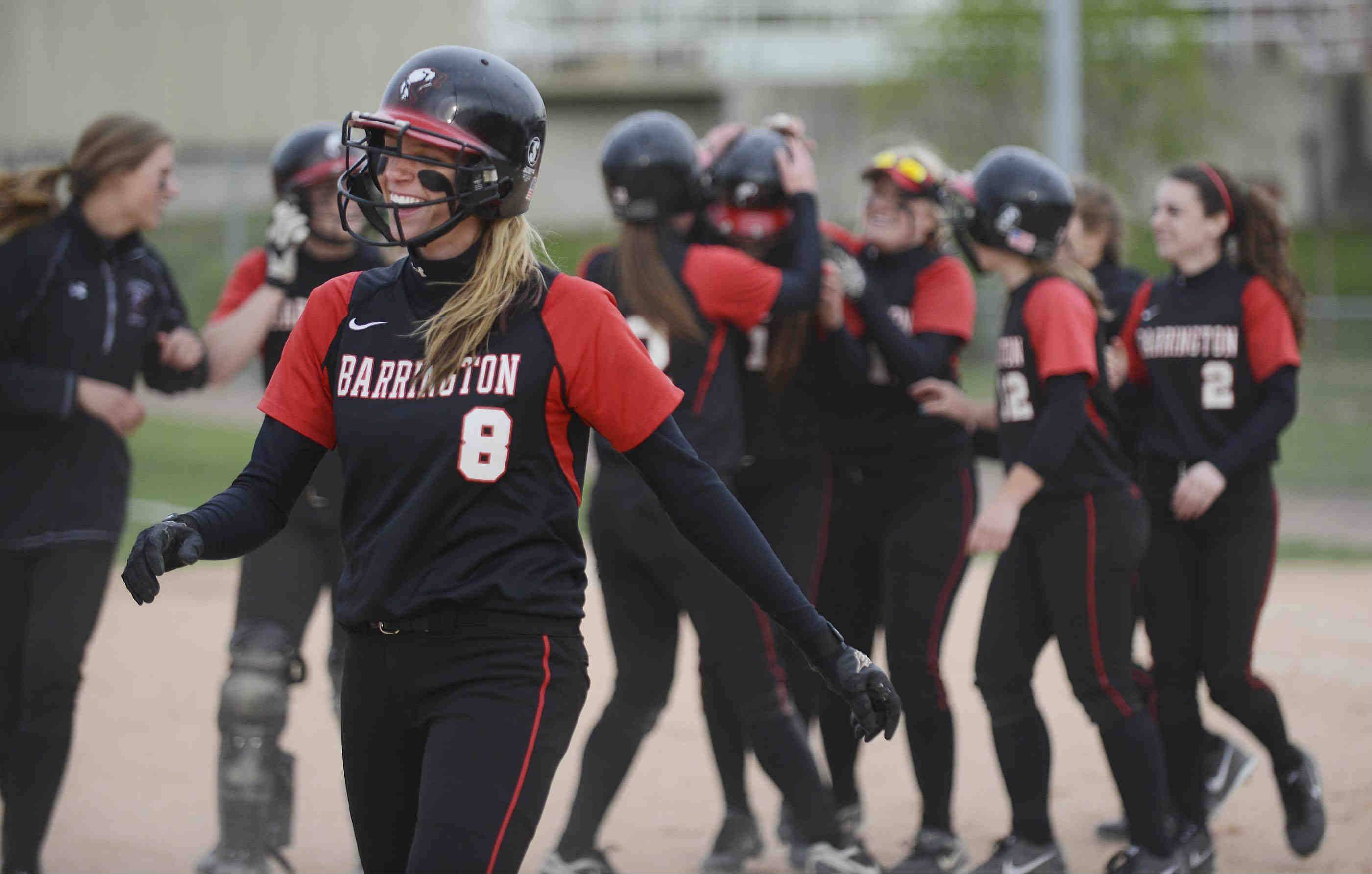 Barrington's Krista Moore laughs as her teammates celebrate behind her after the Fillies defeated Fremd on Monday at the Fields of Dreams. Moore reached on an error in the winning rally.