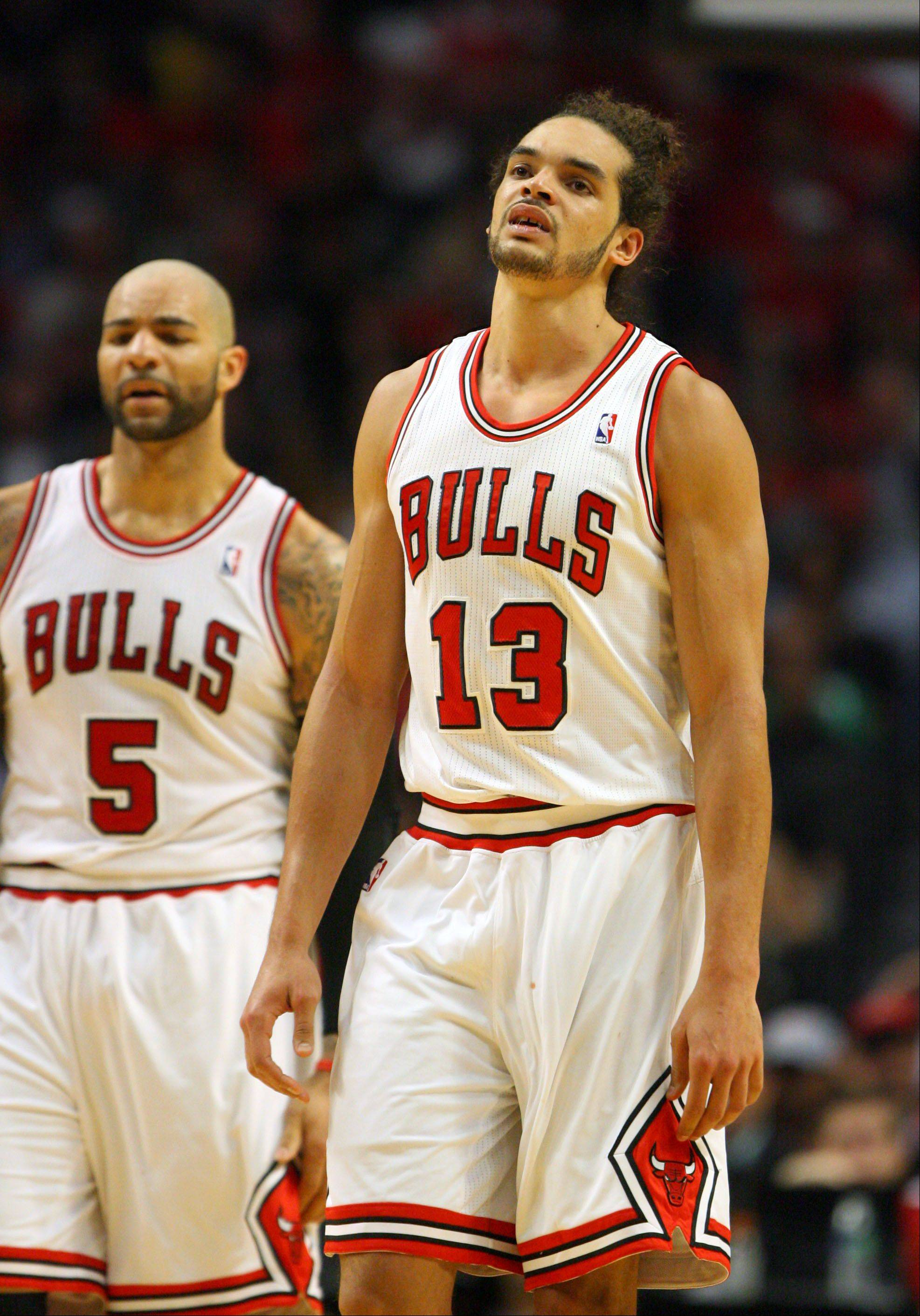 Chicago Bulls center Joakim Noah hangs his head.