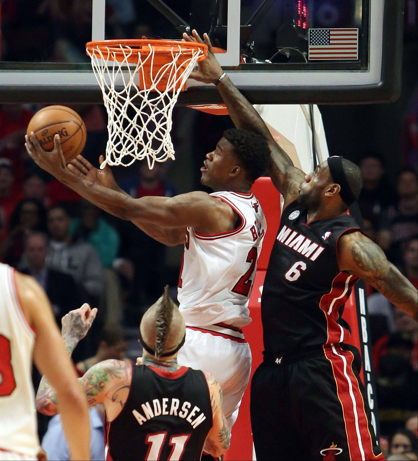 Chicago Bulls small forward Jimmy Butler drives past Miami Heat small forward LeBron James.