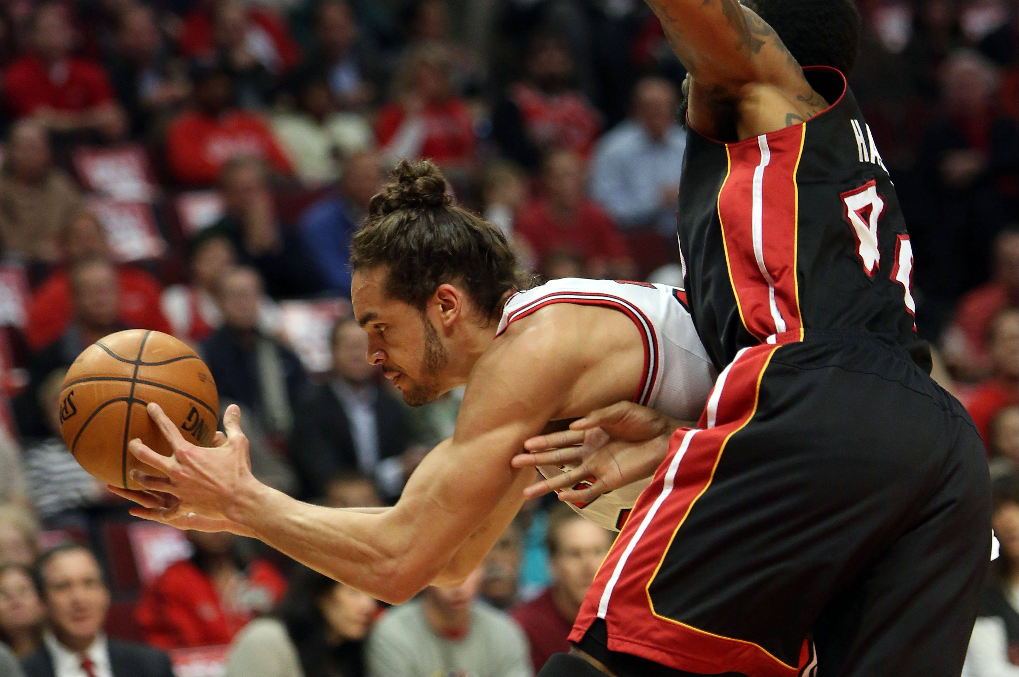Chicago Bulls center Joakim Noah battles for a rebound with Miami Heat power forward Udonis Haslem .