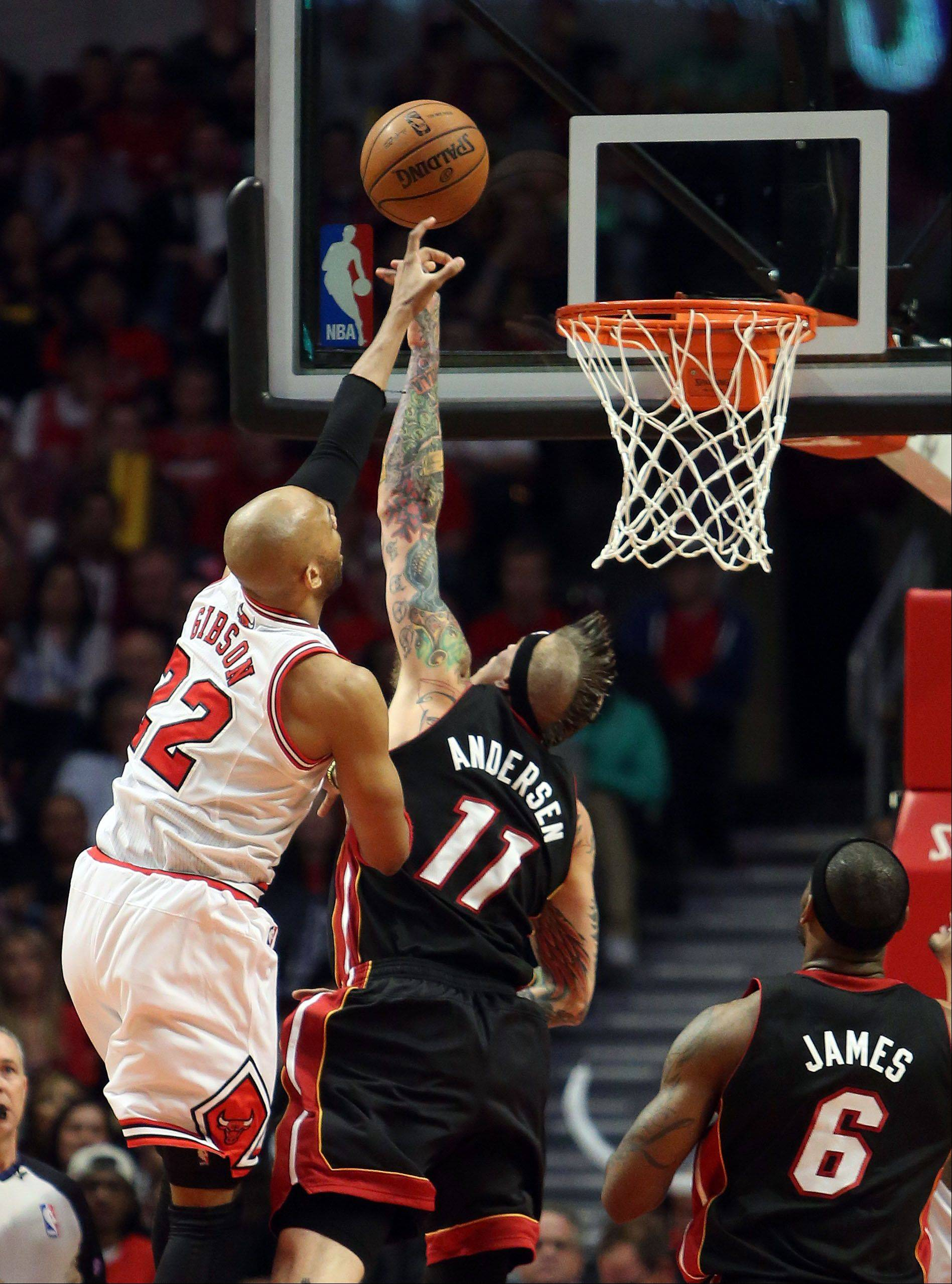 Chicago Bulls power forward Taj Gibson shoots over Miami Heat power forward Chris Andersen .