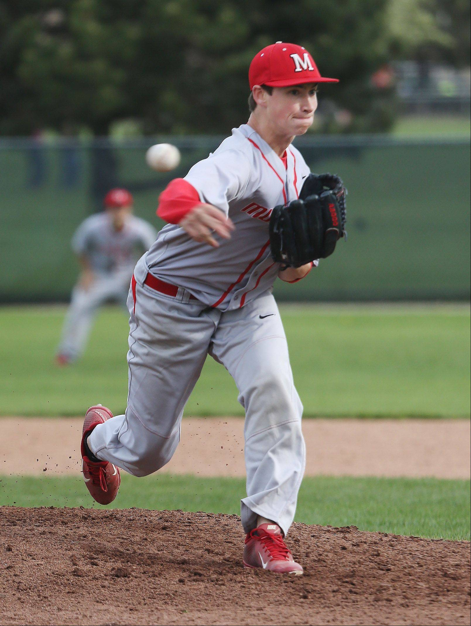 Mundelein pitcher Mitch Schulewitz delivers during the Mustangs' NSC Lake-clinching victory over host Stevenson on Monday.