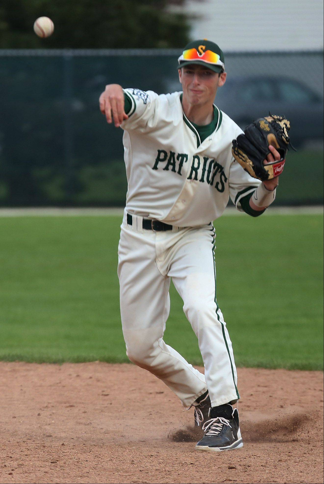 Stevenson second baseman Eli Greenspon throws to first for an out against Mundelein on Monday.