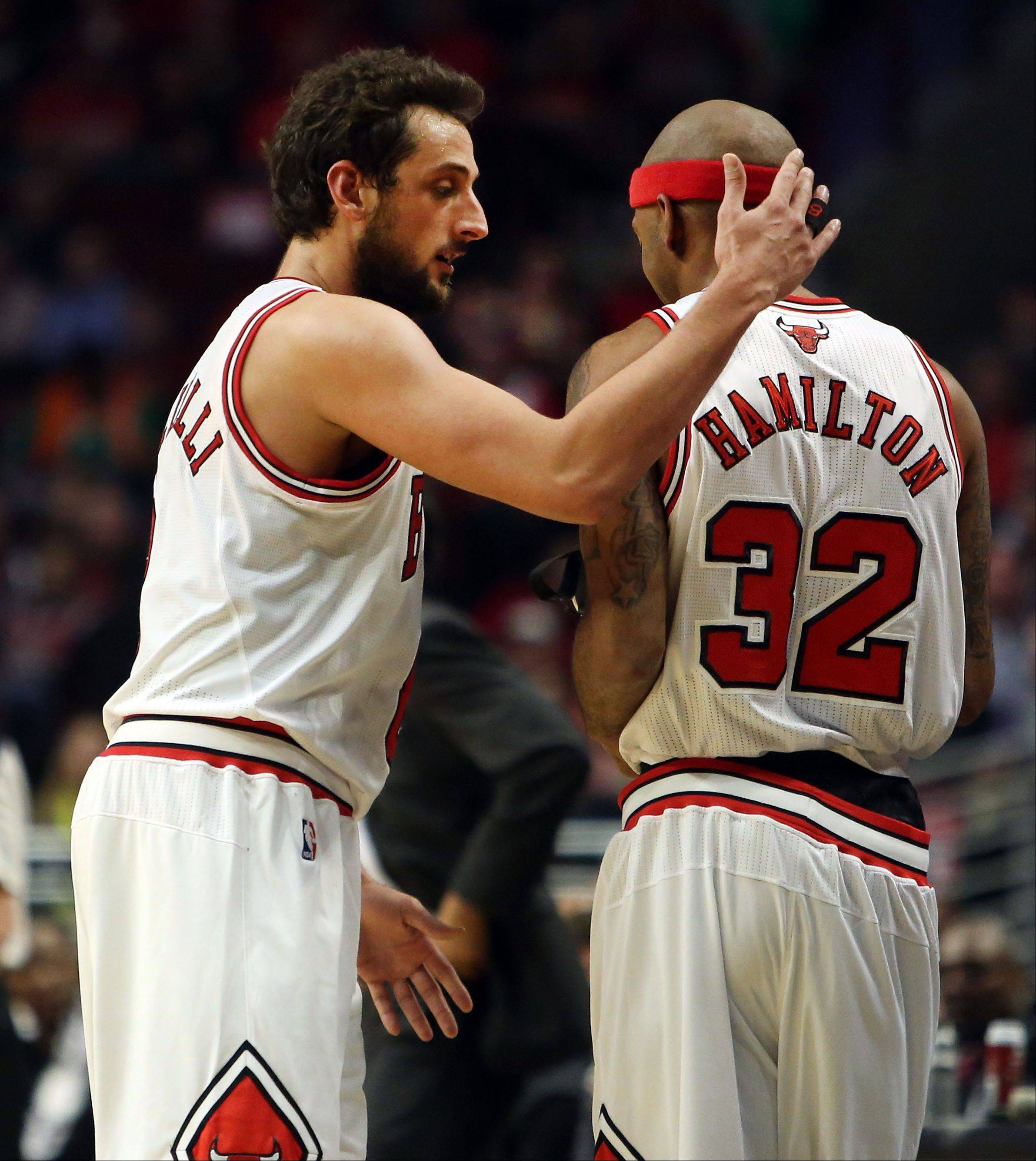 The Bulls' Marco Belinelli welcomes teammate Richard Hamilton into the game Monday night at the United Center. After missing a long stretch late in the season with a back injury, Hamilton made just two brief appearances in the first round against Brooklyn and hadn't played at all in the Miami series. He finished with 11 points in 22 minutes in Game 4.