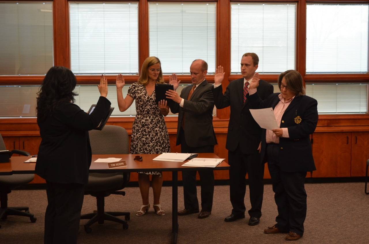District 70 Board President Maryann Ovassapian, far left, swears in a new board, including, from left to right, incumbents Julie Damenti and Tom Vickers, along with new comers Luke Stowe and Wendy Schilling.