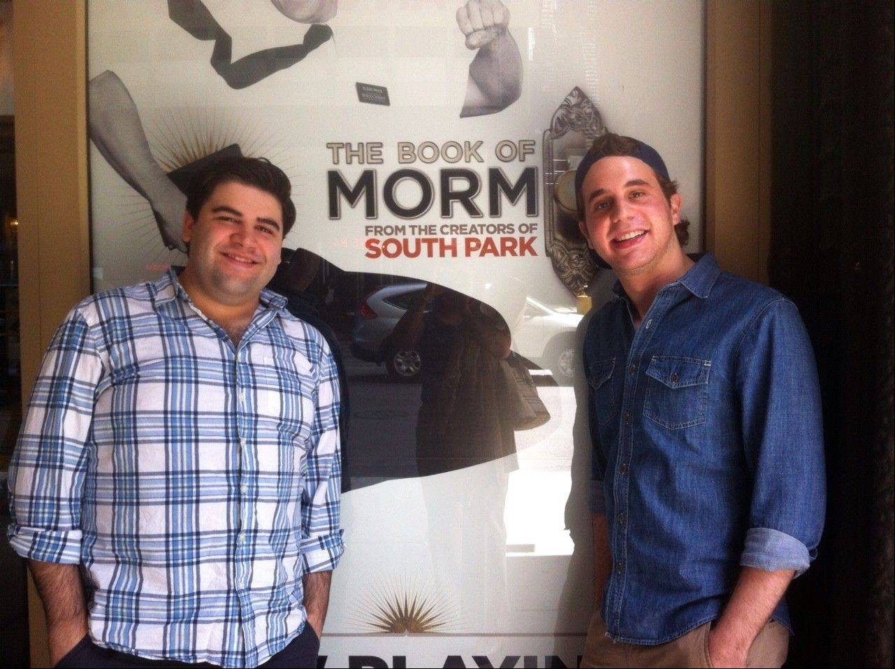 "Rob Colletti, left, and Ben Platt, pose in front of the Bank of America Theatre in Chicago. Platt plays nerdy but lovable Elder Cunningham in ""The Book of Mormon,"" and Colletti, who grew up in Wheaton and Glen Ellyn, is his standby."