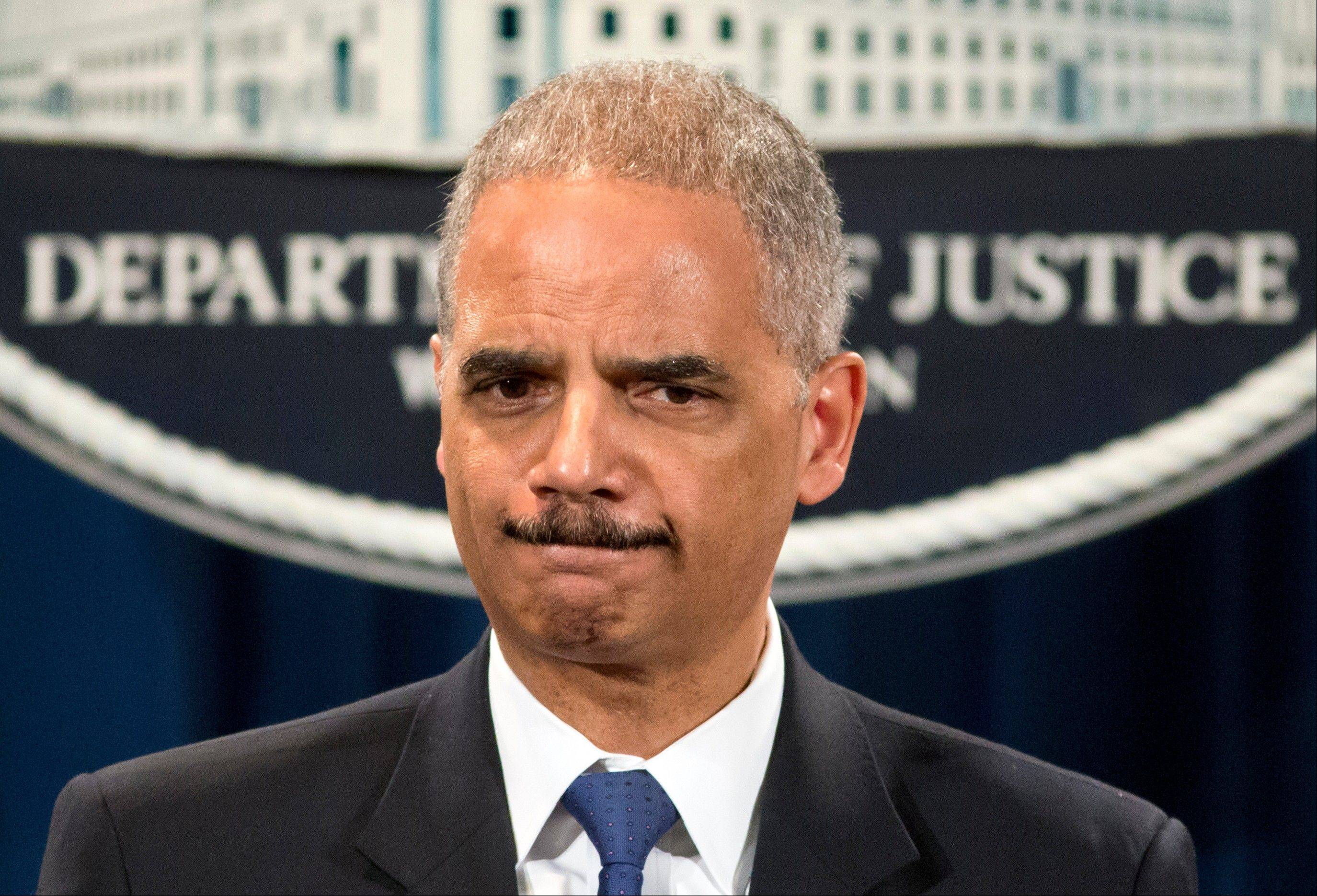 Attorney General Eric Holder, during a news conference Tuesday, is questioned about the Justice Department secretly obtaining telephone records of reporters and editors for The Associated Press.