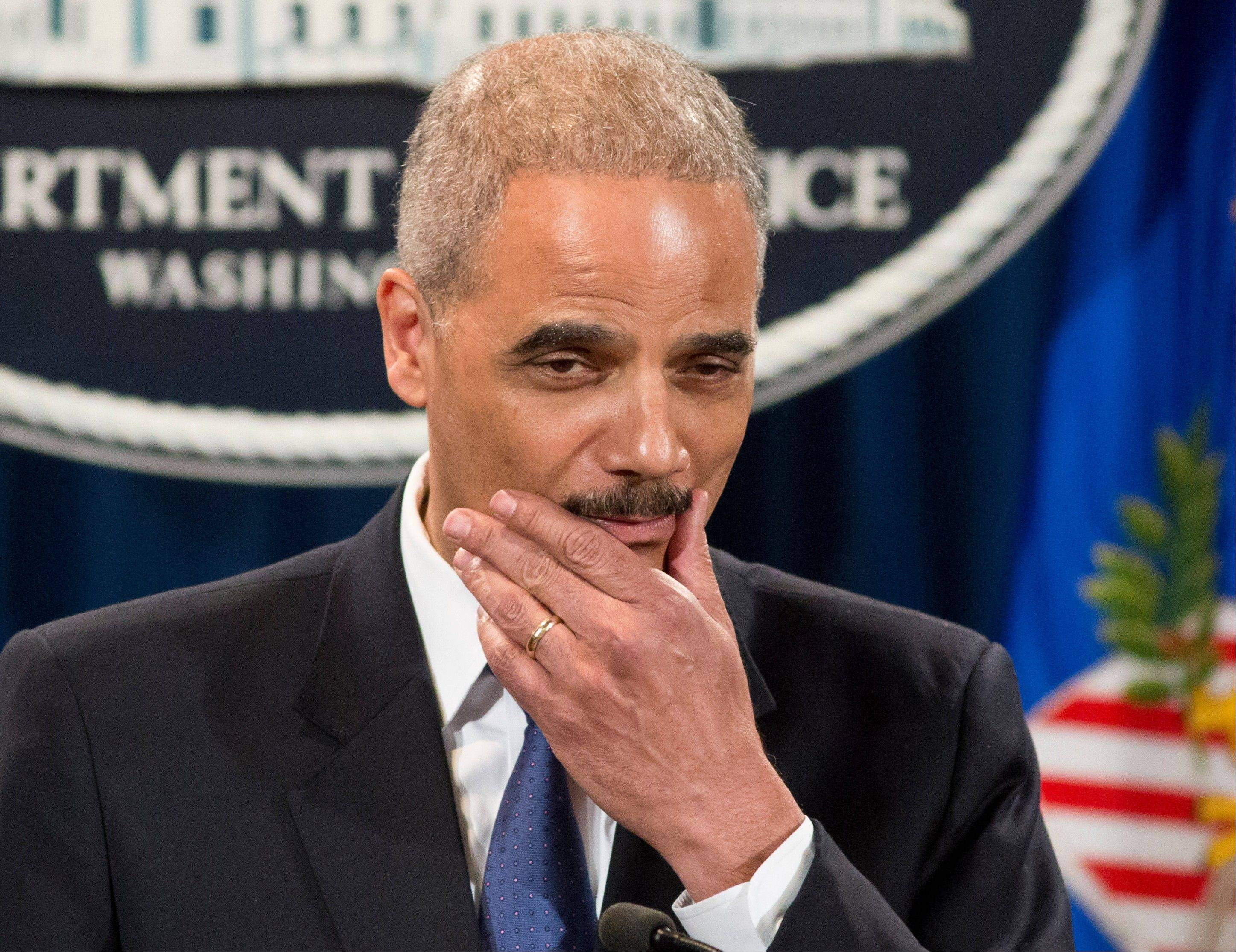Attorney General Eric Holder pauses during a news conference at the Justice Department in Washington Tuesday. Holder said he�s ordered a Justice Department investigation into the Internal Revenue Service�s targeting of conservative groups for extra tax scrutiny.