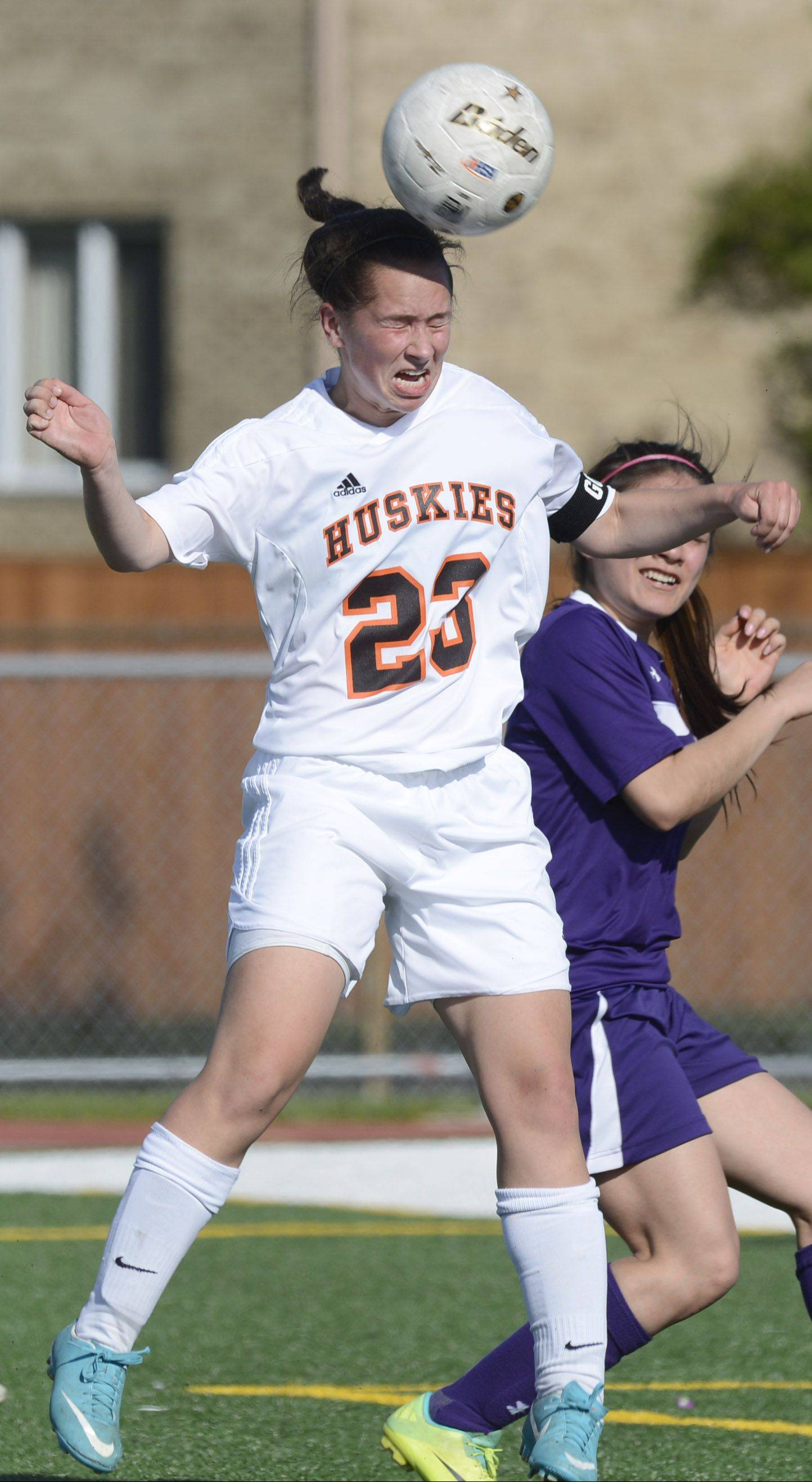 Hersey�s Lauren Gierman, left, leaps for a header next to Waukegan�s Jasmine Res. Gierman scored twice in the Huskies� 7-0 triumph; Hersey will host Stevenson in regional final play Friday.