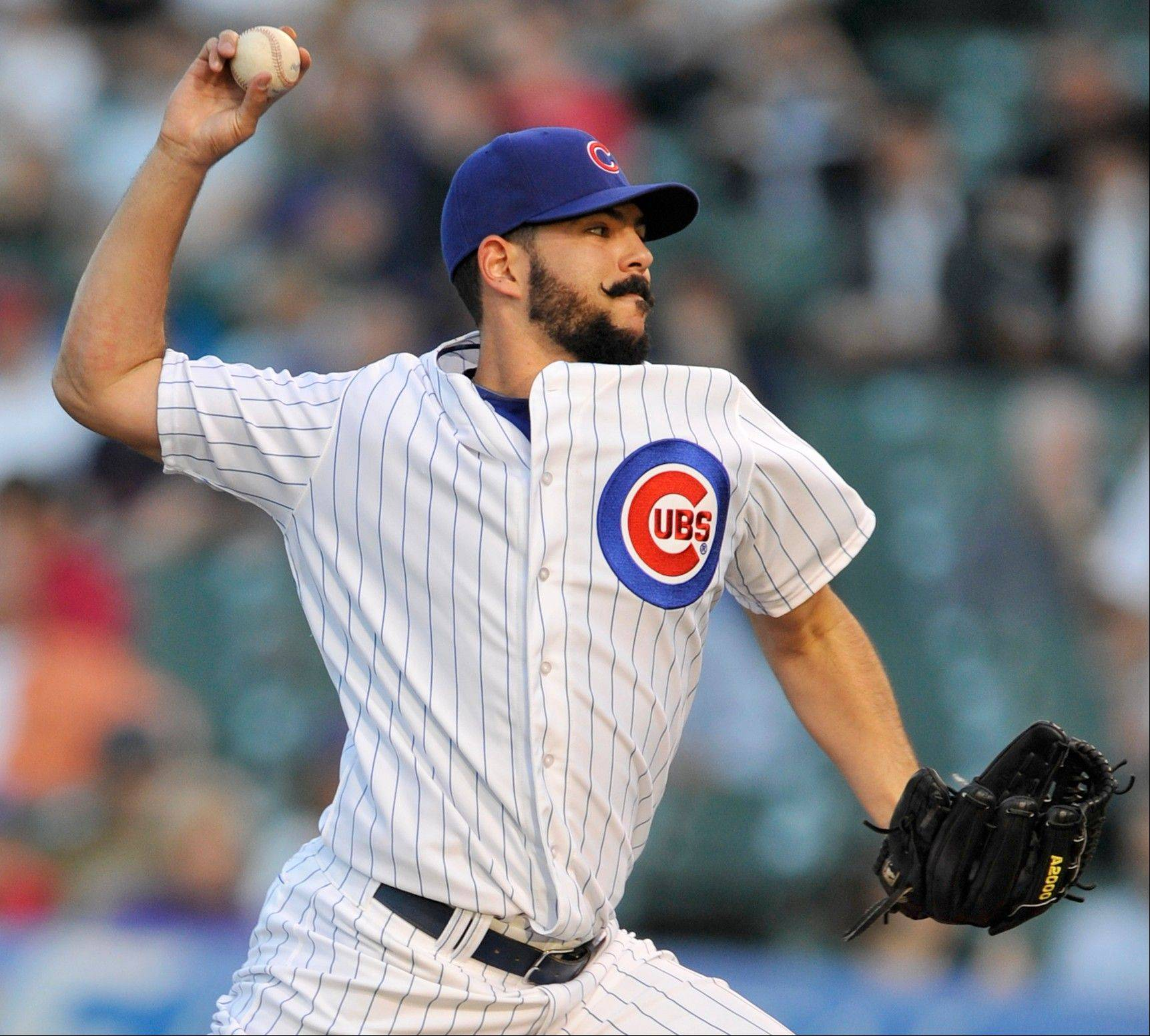 Chicago Cubs starter Carlos Villanueva delivers a pitch against the Colorado Rockies during the first inning of a baseball game in Chicago, Tuesday, May 14, 2013. (AP Photo/Paul Beaty)