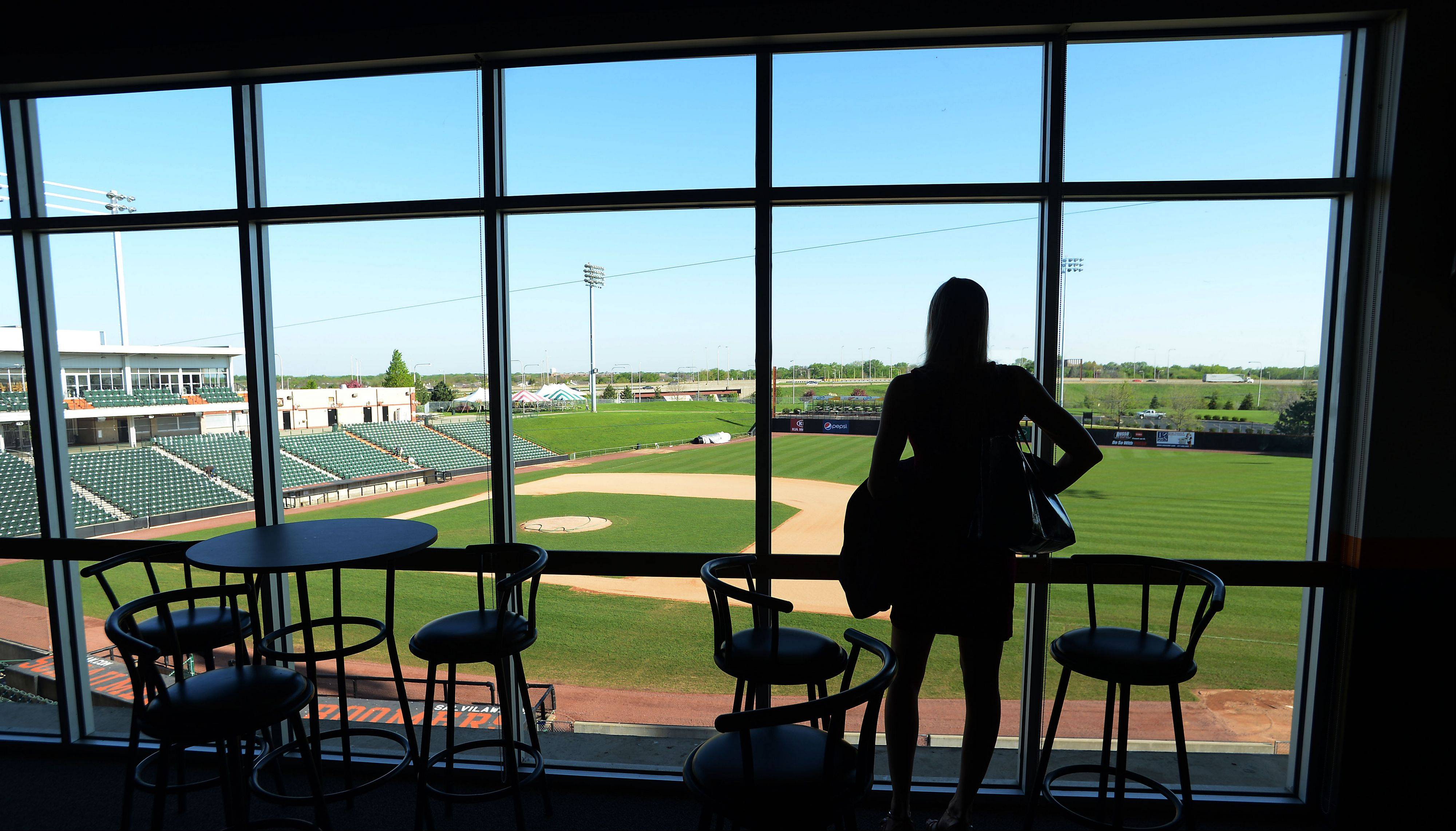 Katie Berganske of AmCheck Payroll in Schaumburg looks out on to the Schaumburg Boomers baseball field through new windows at the SBA monthly breakfast on Tuesday.