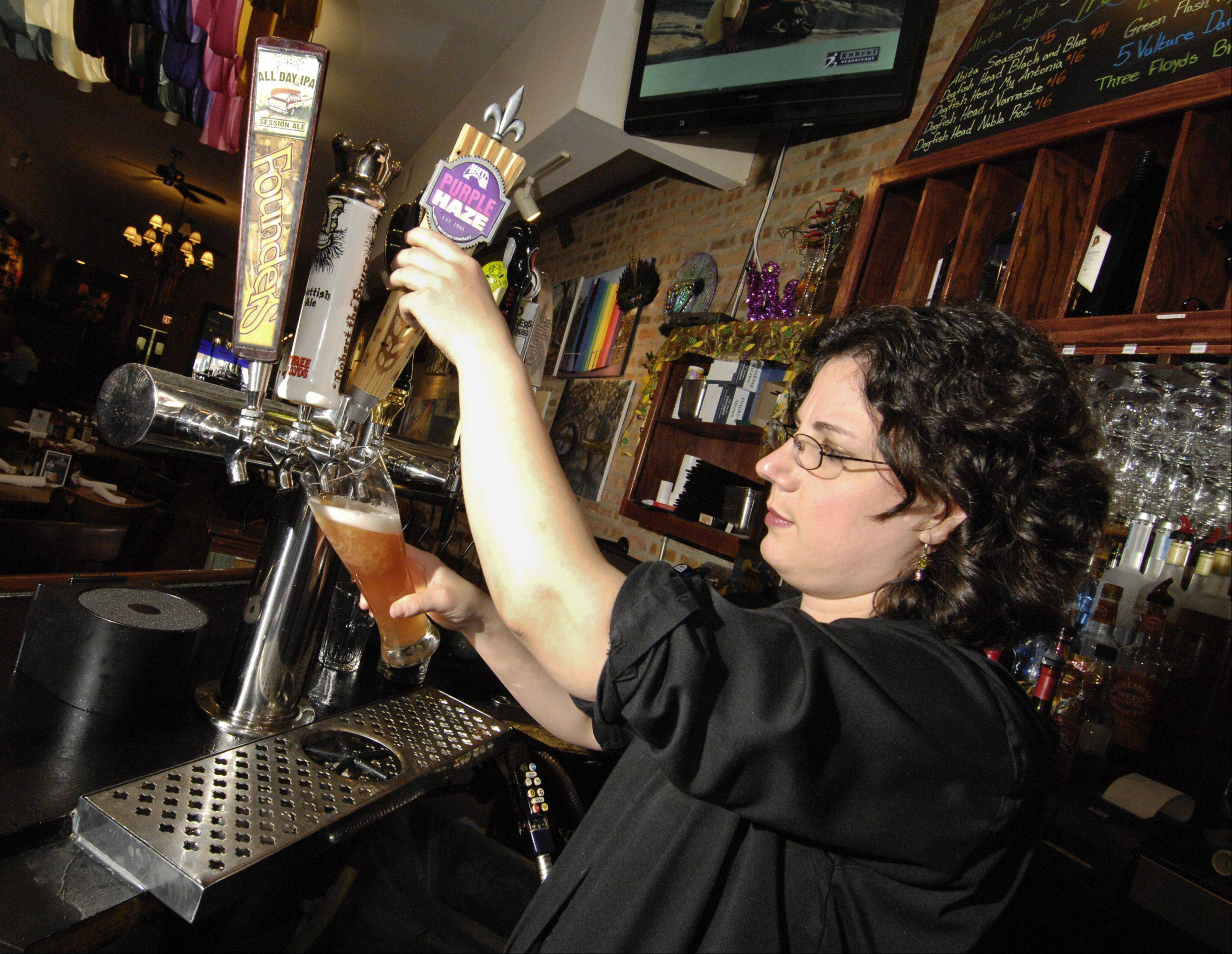 Bartender Ashley Penick pours a Purple Haze at Heaven on Seven in Naperville. The restaurant is one of many participating in Chicago Craft Beer Week.