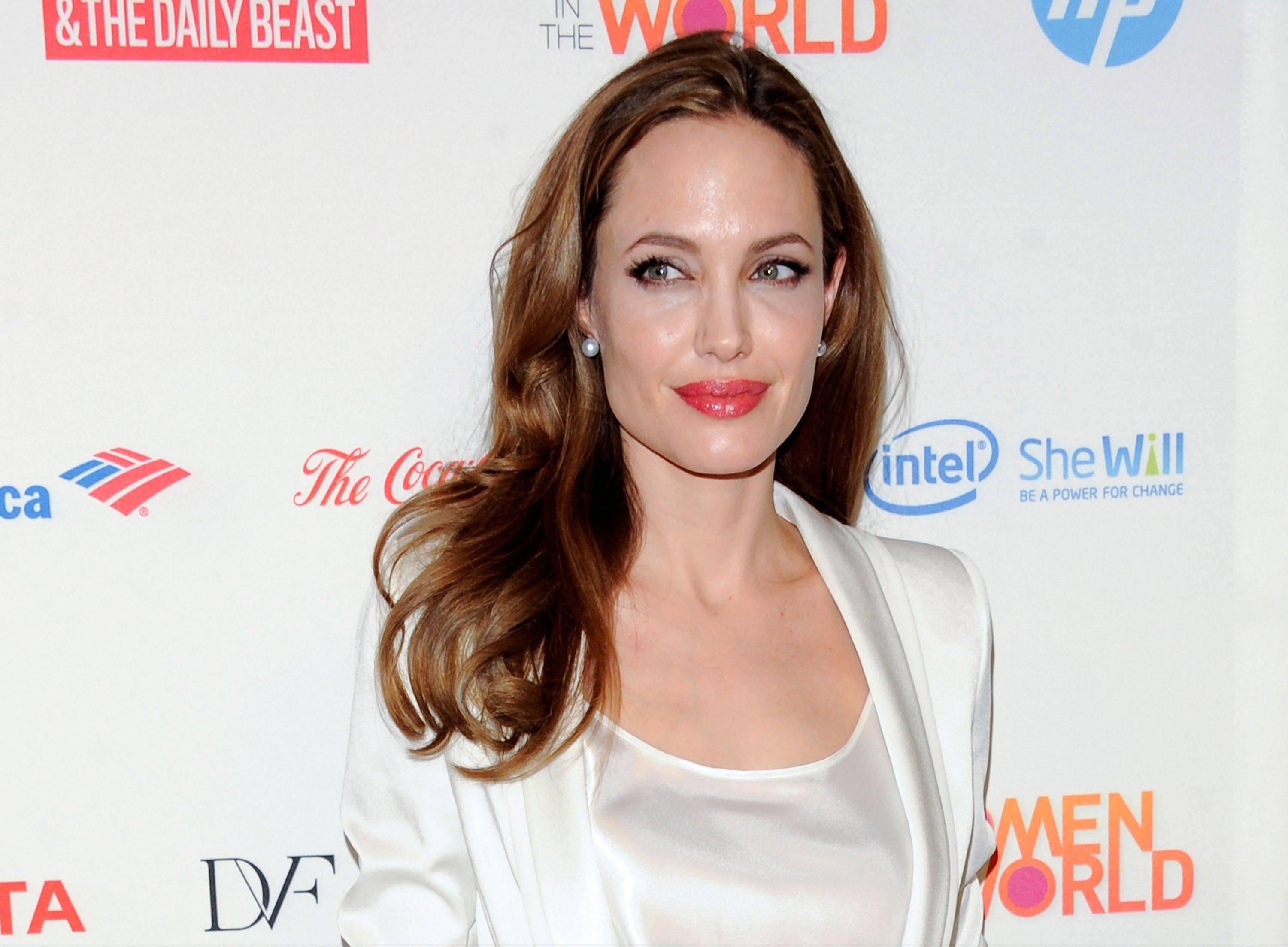Actress Angelina Jolie authored an op-ed for Tuesday's New York Times where she writes that in April she finished three months of surgical procedures to remove both breasts as a preventive measure. She says she's kept the process private but is writing about it now with hopes she can help other women.