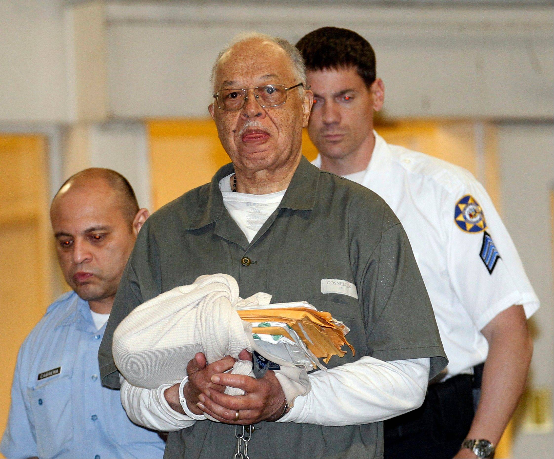 Dr. Kermit Gosnell is escorted to a waiting police van upon leaving the Criminal Justice Center in Philadelphia Monday after being convicted of first-degree murder in the deaths of three babies delivered alive and then killed.