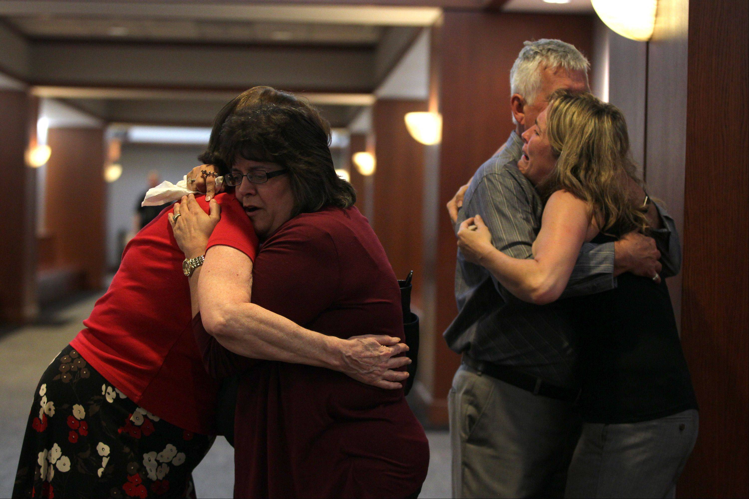 Friends and relatives of the Kramer family embrace Tuesday at the DuPage County courthouse in Wheaton after Johnny Borizov was found guilty of directing the murders of Jeffrey Kramer, his wife, Lori, and their son Mike.
