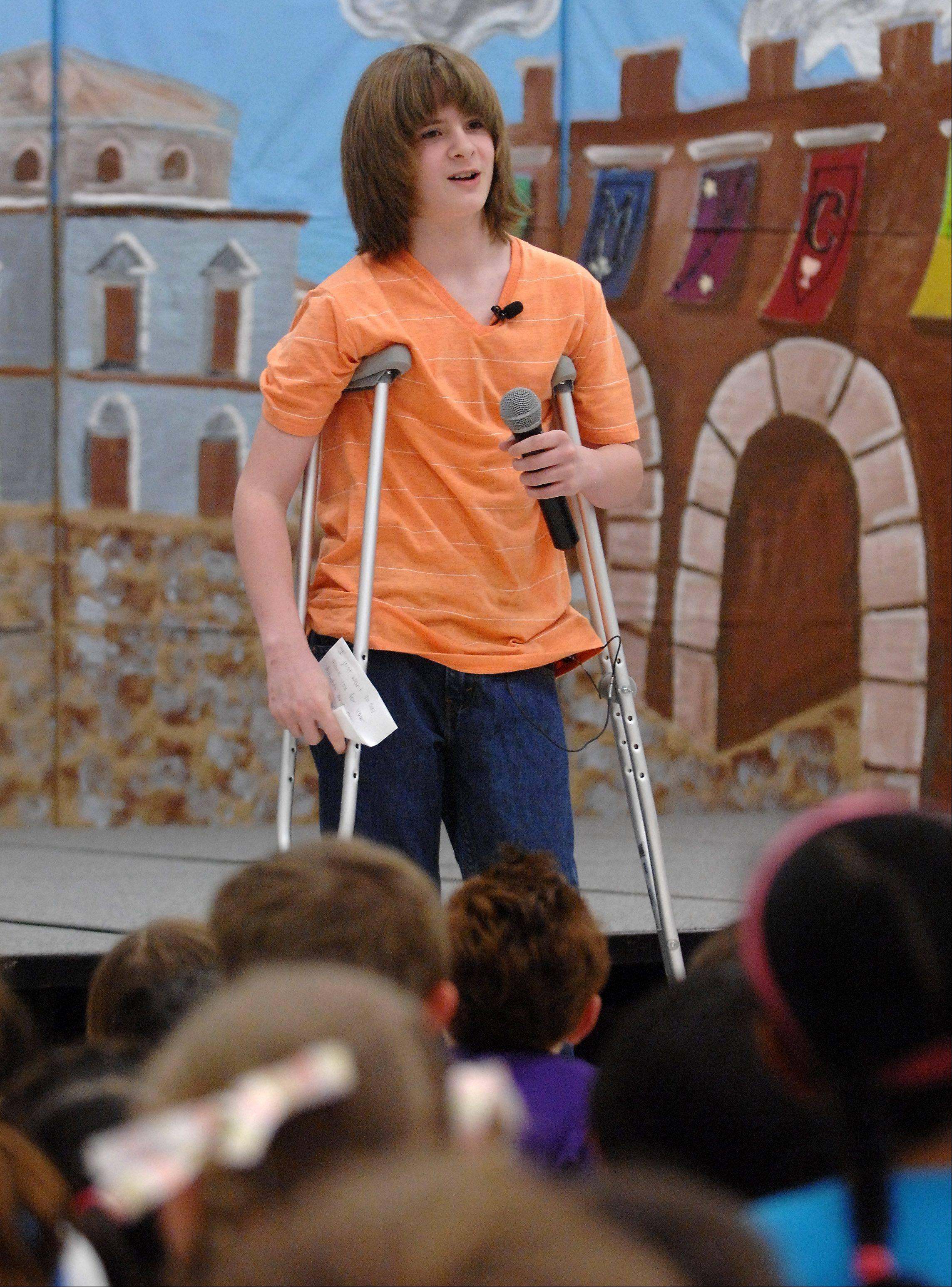 Dominic Szymanski, 11, addresses his classmates after returning to Hough Street School in Barrington for the first time since losing his foot after being struck by a train in March. He is a fifth-grader at the school.